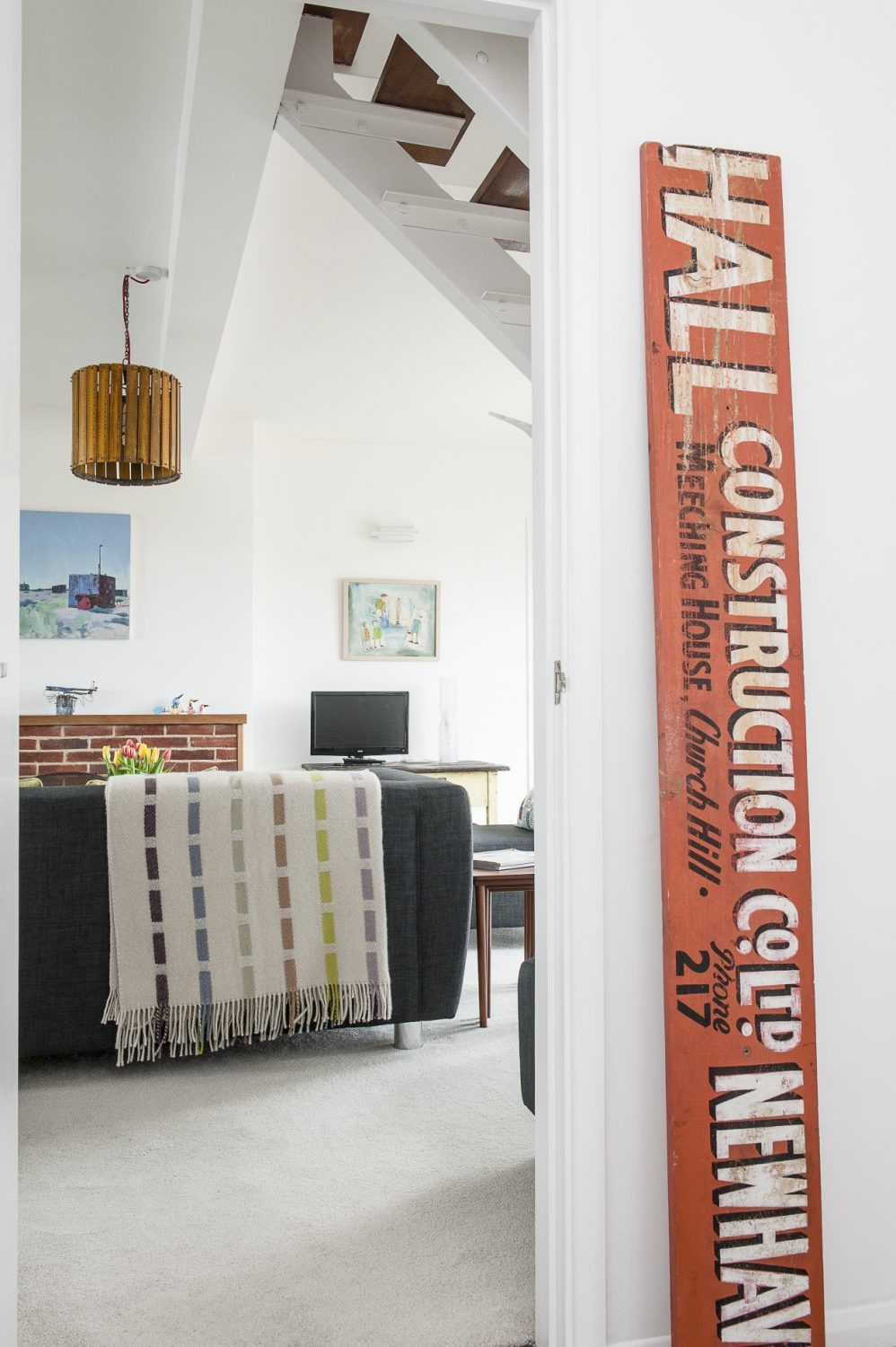 The use of bold and sizeable reclaimed signs is a recurrent theme in each room