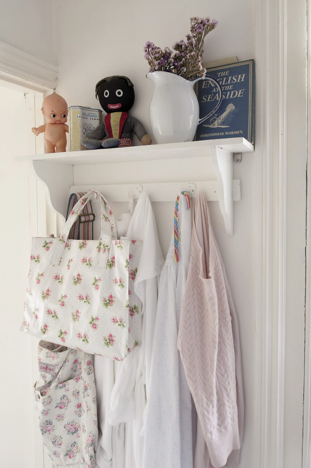 More of Anastasia's eclectic collections line a shelf in the entrance to the bathroom