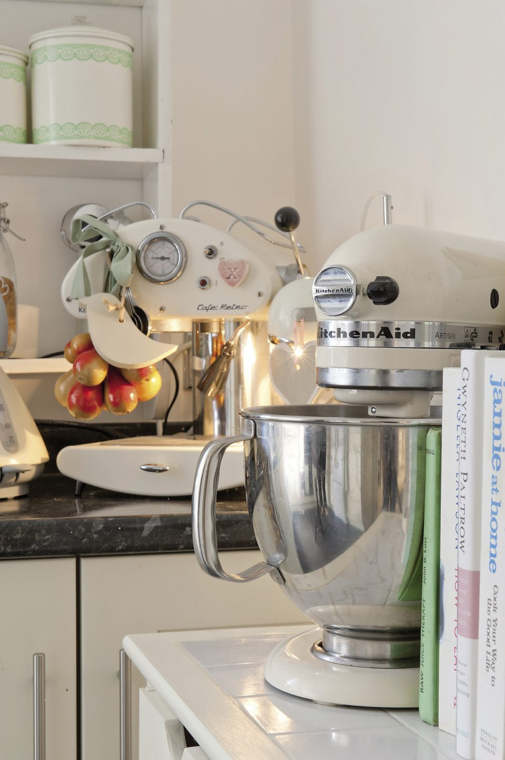 The kitchen gadgets are almost all original classics of industrial design such as Anastasia's treasured KitchenAid food mixer