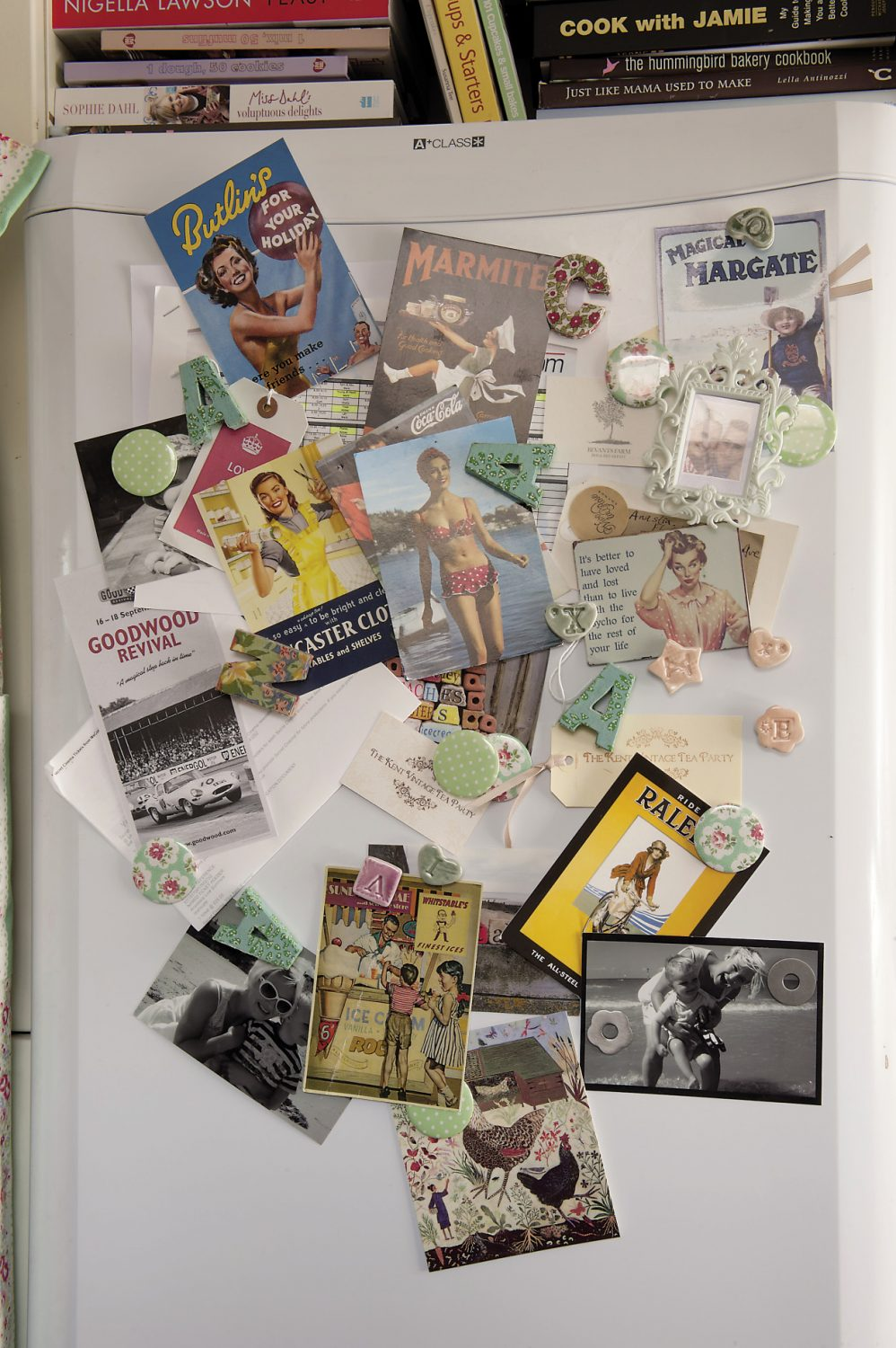 The fridge is covered in vintage postcards, photographs and seaside nostalgia