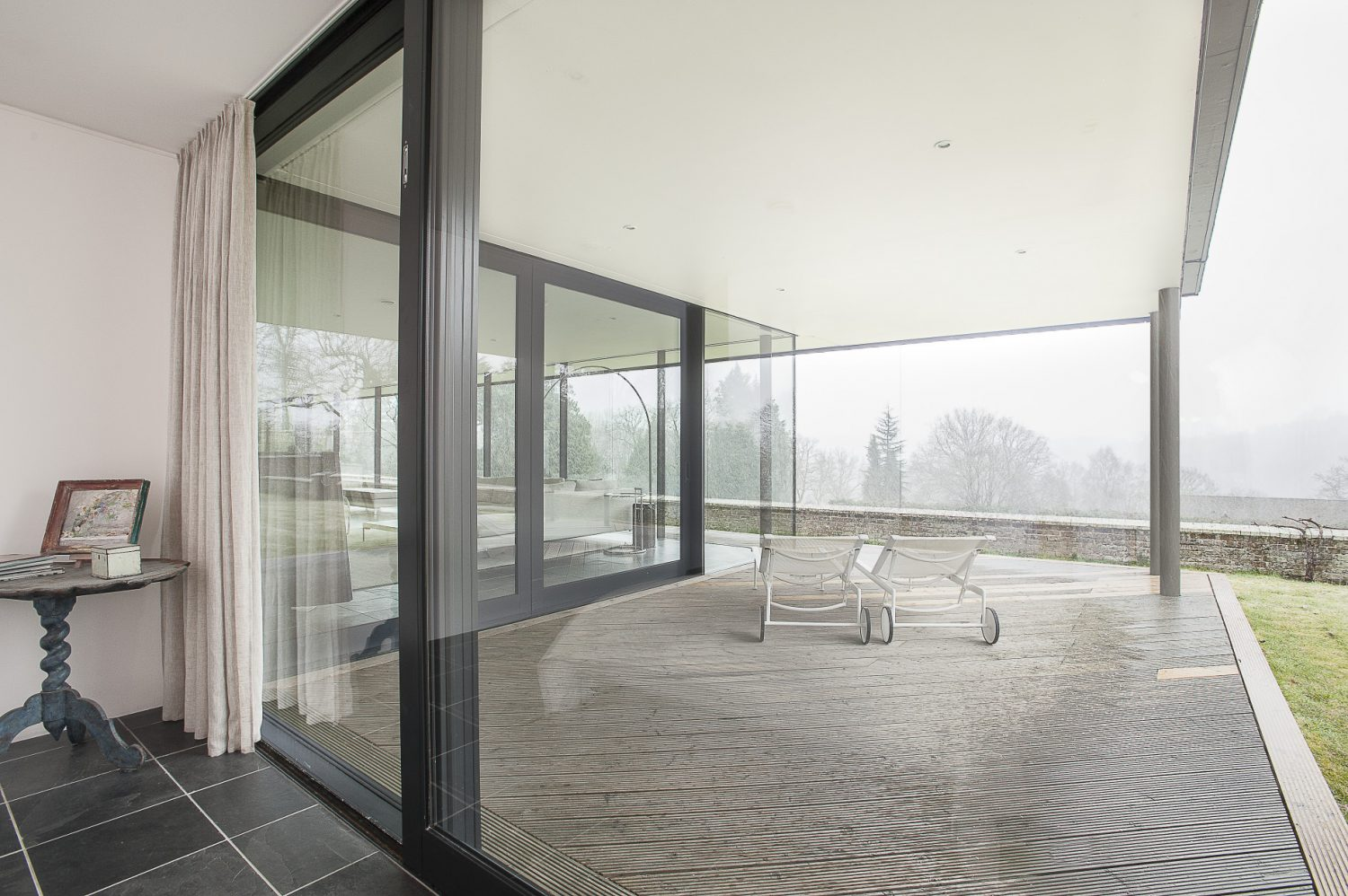 Full height glass doors slide open to allow access onto the terrace in the second bedroom