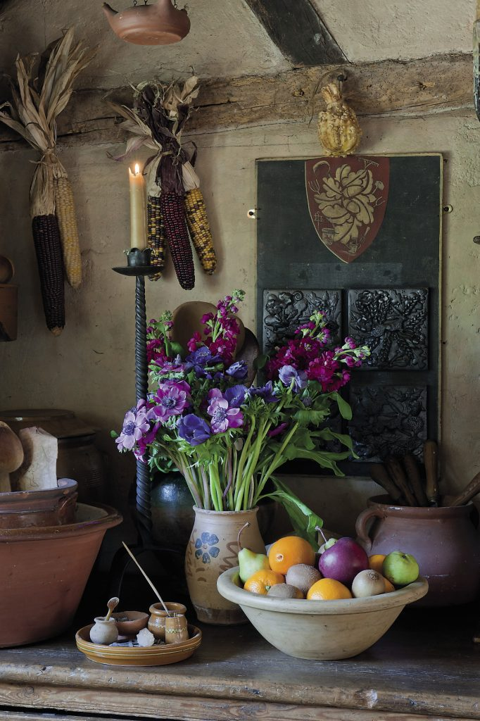 The house is around 300 years old and the kitchen was once a scullery and shed. Oil lanterns and iron game hangers are suspended from the exposed beams. Under the floor is a 30ft well