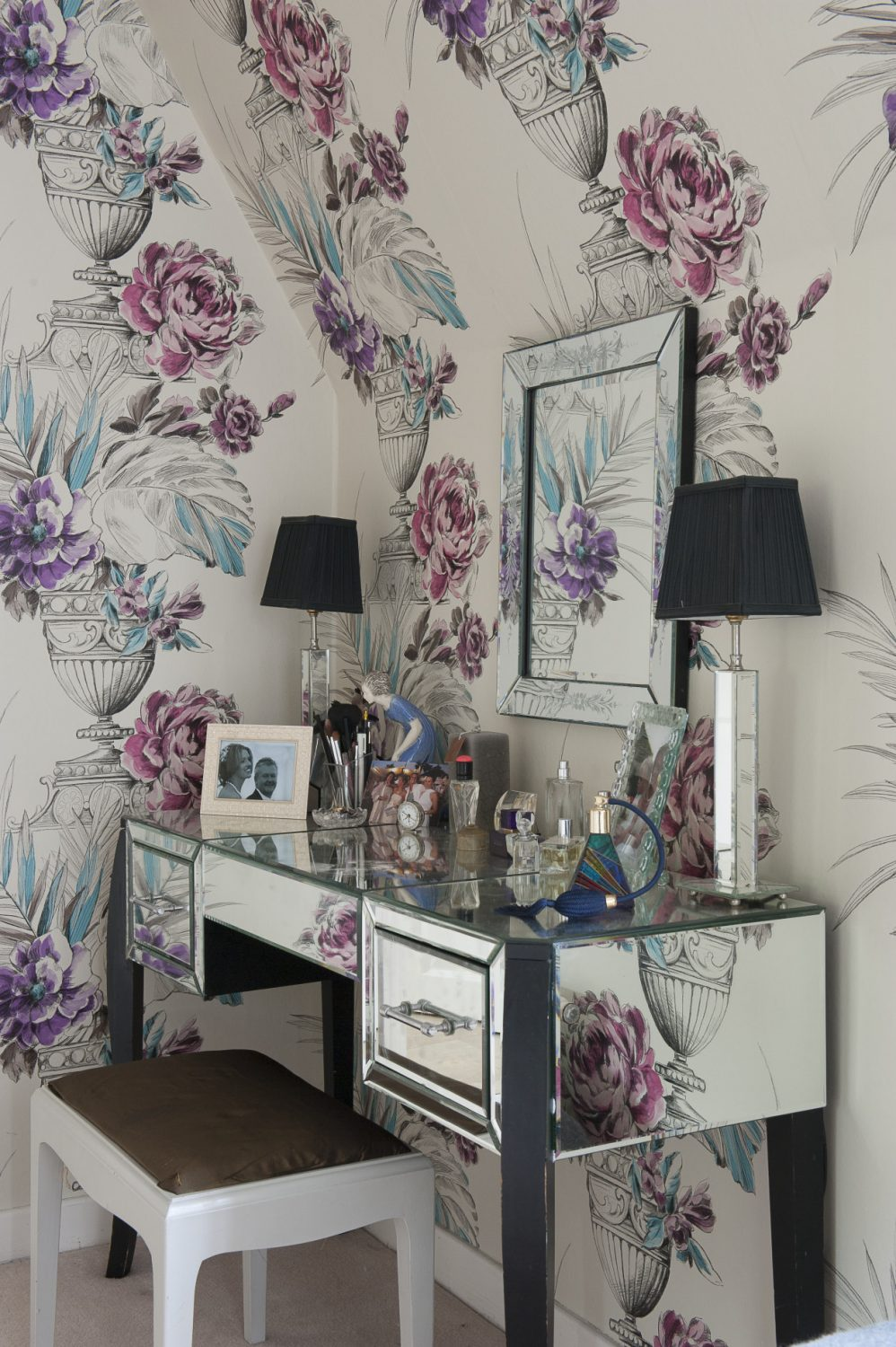 A glamorous mirrored dressing table provides the focal point of Steph's dressing area