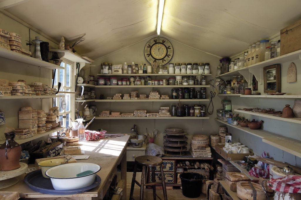Claudine's studio shed is home to her workbench and a potter's wheel, so she can throw, cast, or hand build her pots, tiles and plaques