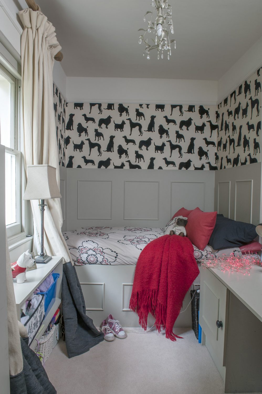 Younger daughter, Emily's room has been papered in Osborne & Little's 'Walk in the Park' flock wallpaper