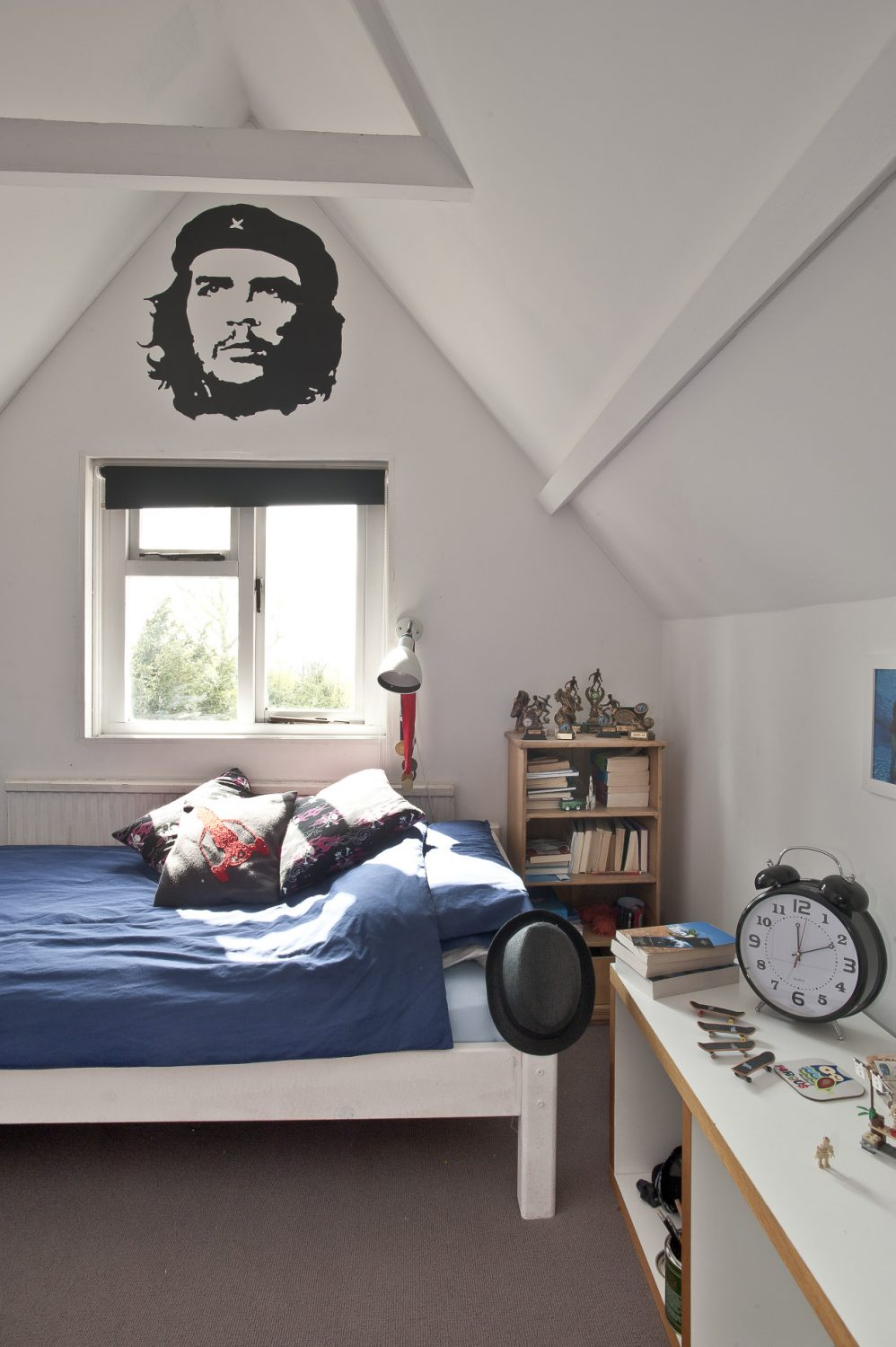 Up a tiny staircase in the vaulted eaves is her son's room, all Airfix and Boys Own stuff