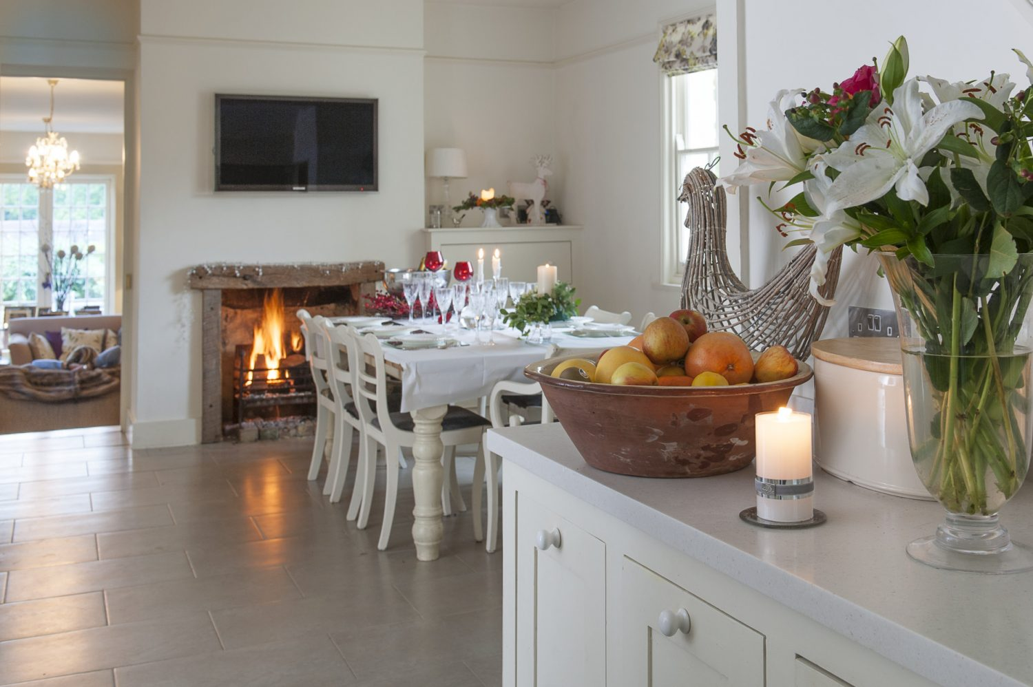 The open-plan kitchen and dining area, complete with open fire