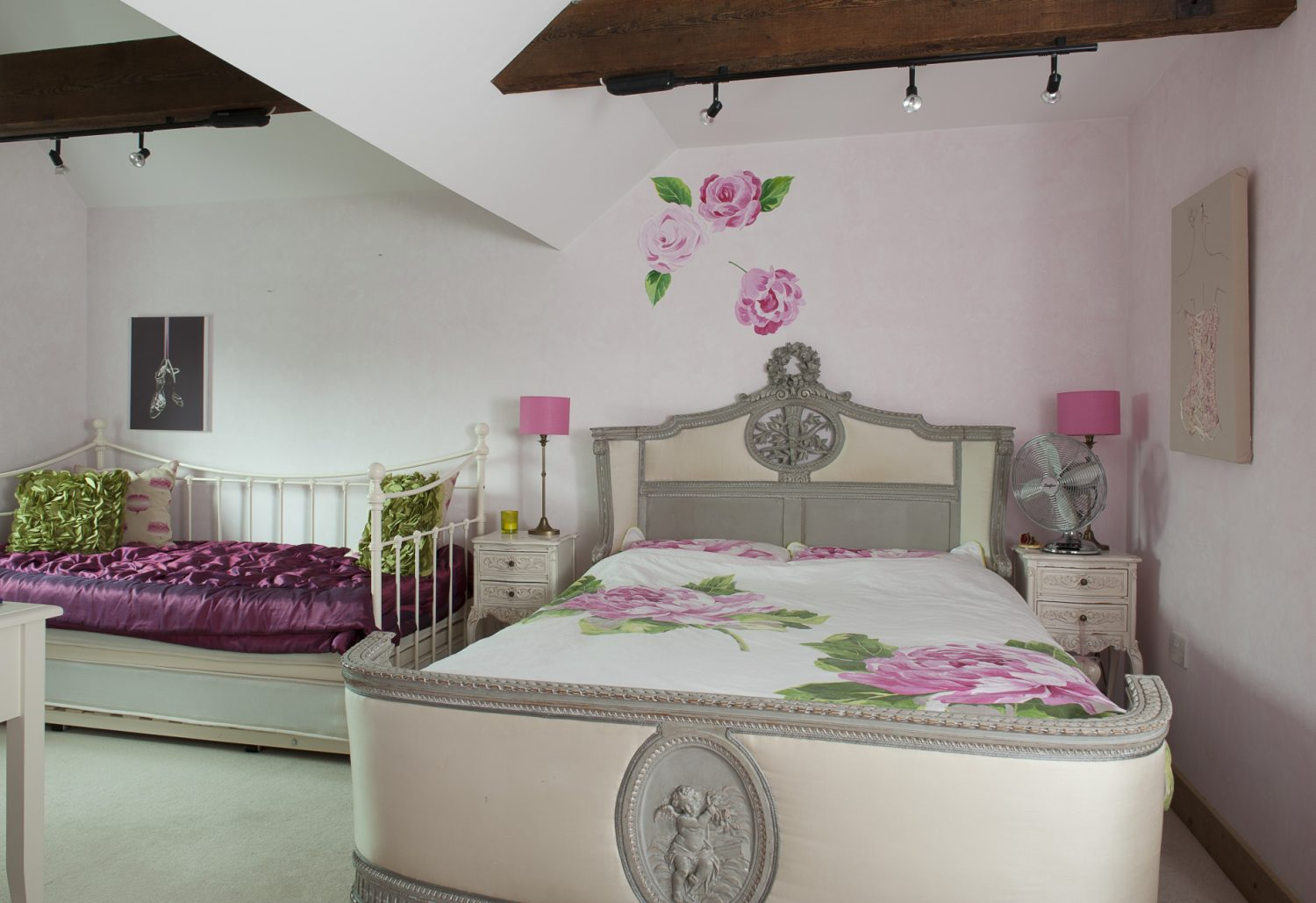 In direct contrast, daughter Maisie's room features an ornately carved 18th century French bed is dressed with a Designers Guild quilt