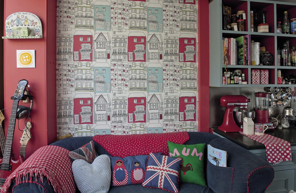 The kitchen is papered with Harlequin's Brighton design which features pen and ink drawings of Brighton houses, both Regency and modern, accentuated with splashes of red and blue.