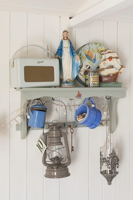 A lantern hangs from shelves in the shepherd's hut