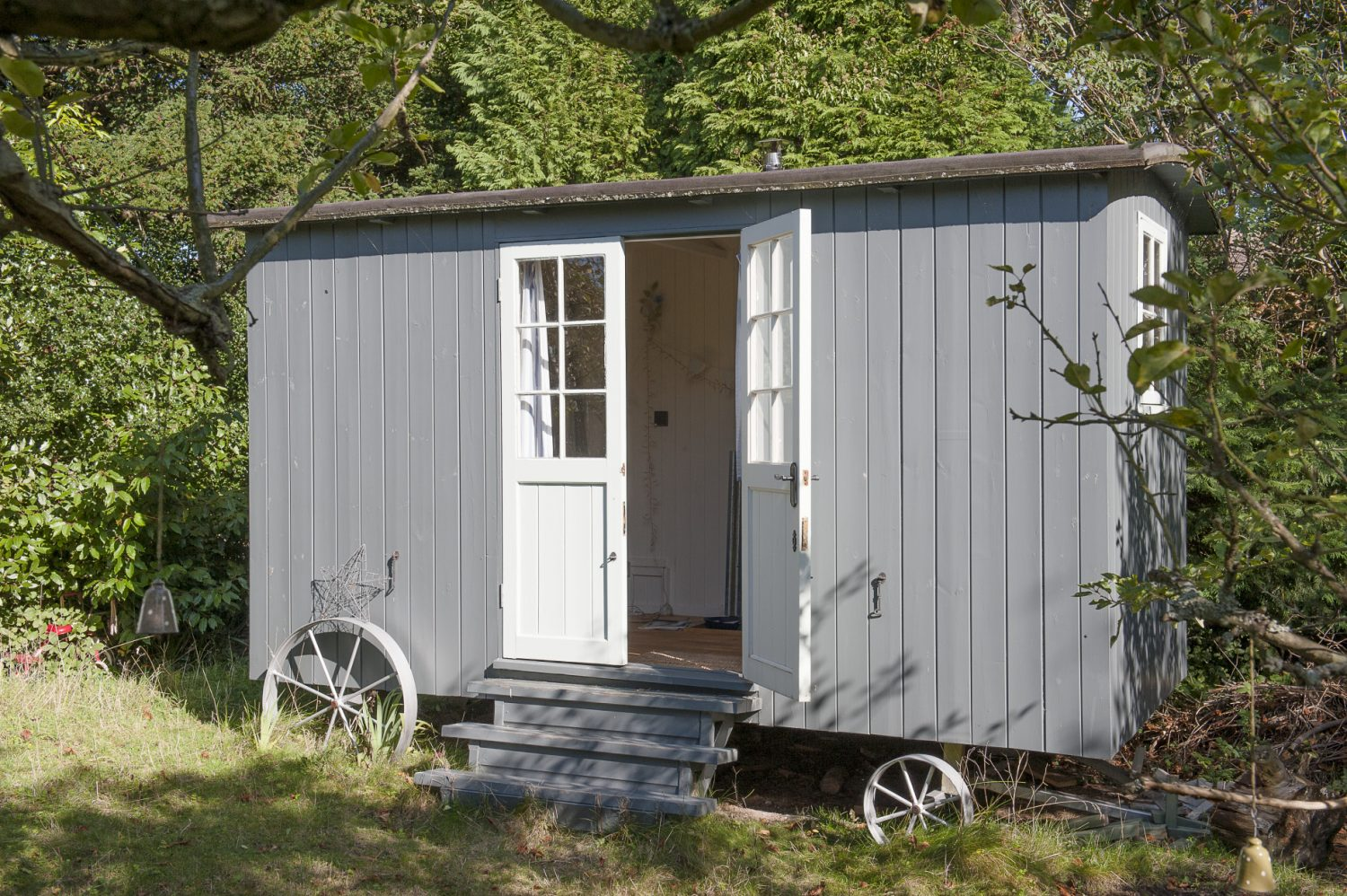 Outside, a shepherd's hut acts as a retreat for the family