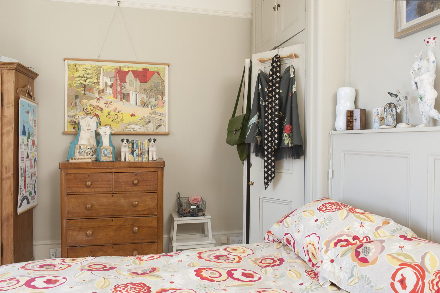 The bed in the master bedroom is dressed with bright, Collier Campbell bedlinen featuring a zinnia-like floral pattern