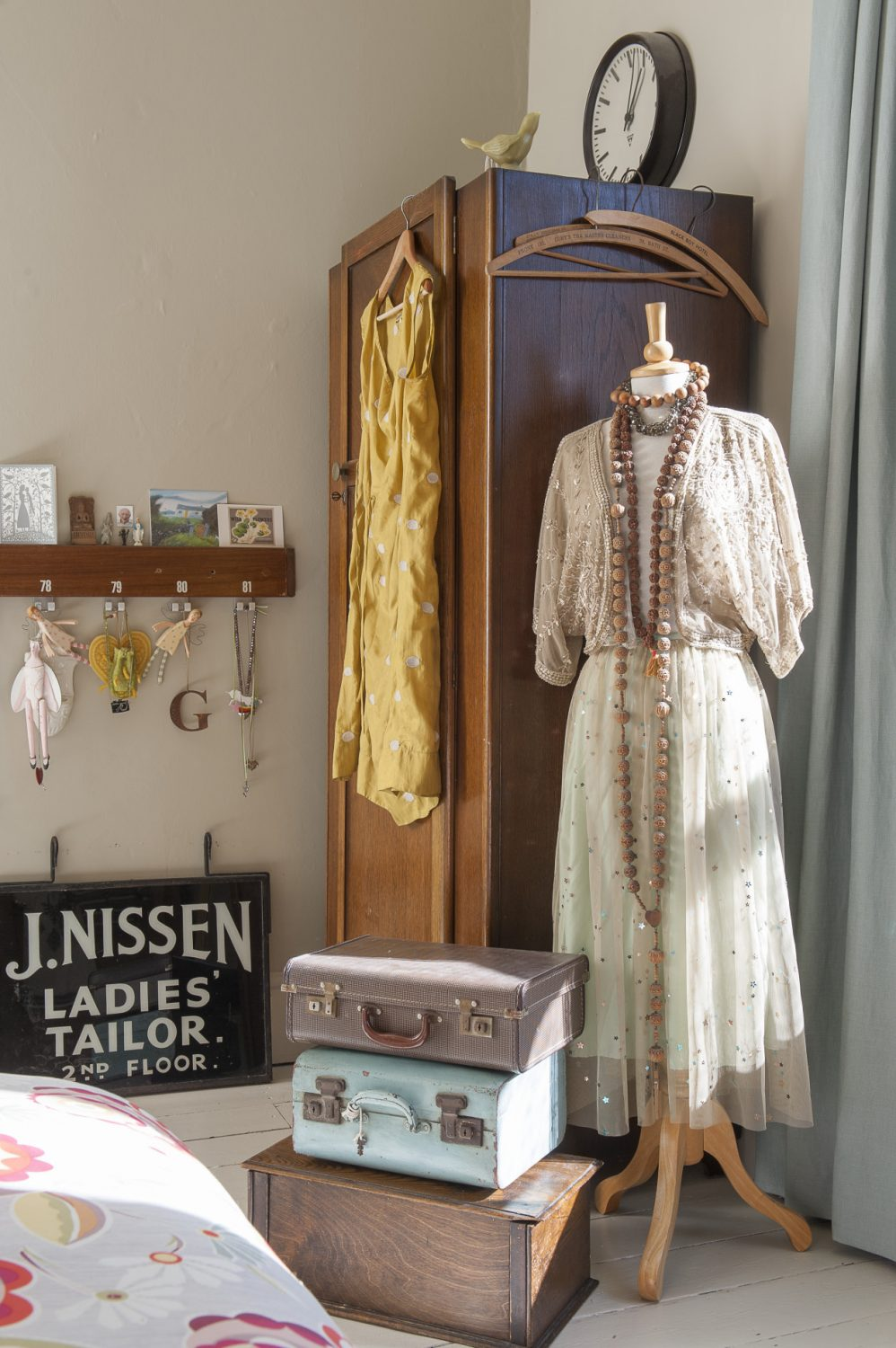 Along the landing, the main bedroom has a stack of vintage cases and boxes and a classic late 1930s oak wardrobe that belonged to Sarah's grandad