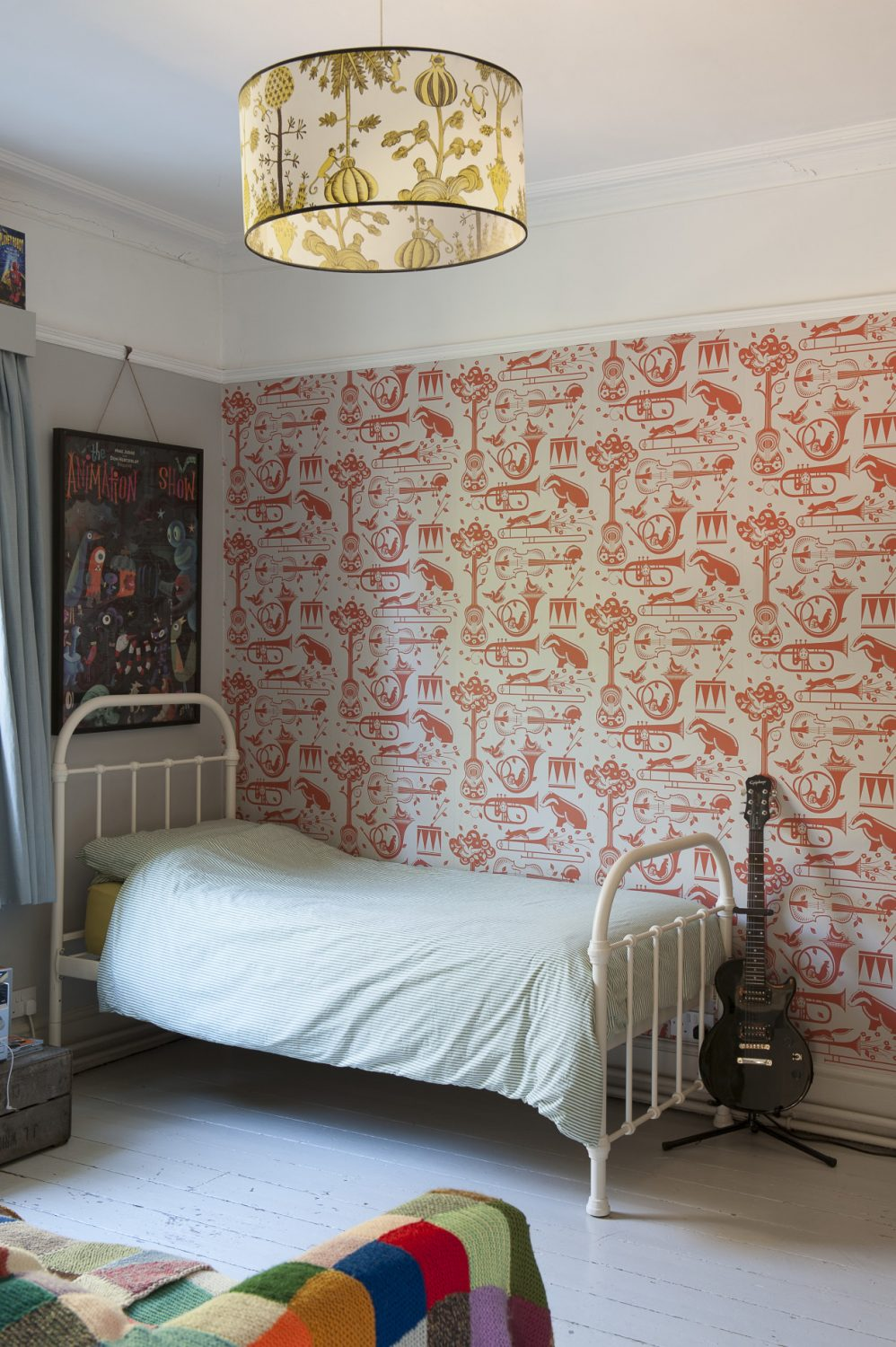 the Mini Moderns wallpaper that features an eccentric mix of French horns, drums, cockerels and badgers