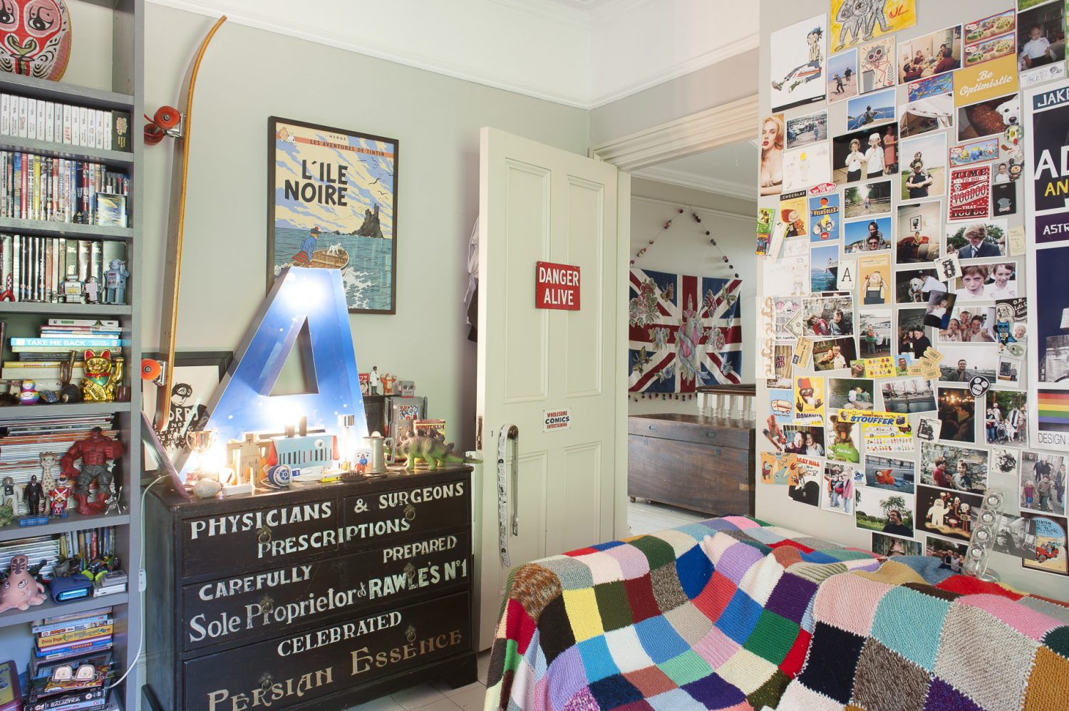 In the couple's son's room a tall shelving unit, made especially for his godson by carpenter Rupert Walton, fills the major part of one wall and is stuffed with an impressively tidy collection of books, CDs, DVDs and a few favourite toys
