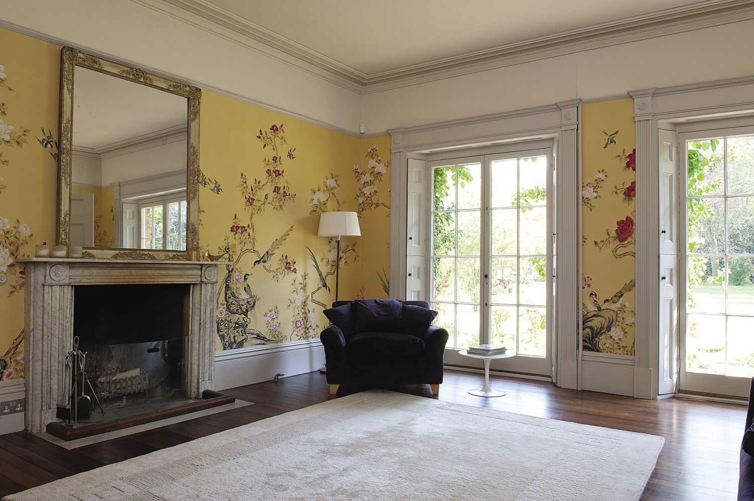"""In the drawing room the walls have been covered with golden yellow silk that has been hand-painted with exquisitely detailed Chinese birds, trees and flowers. """"I saw it in the de Gournay showroom when we lived in London and I used to think, 'one day, I hope to have a house worthy of it',"""" remembers Gabby"""