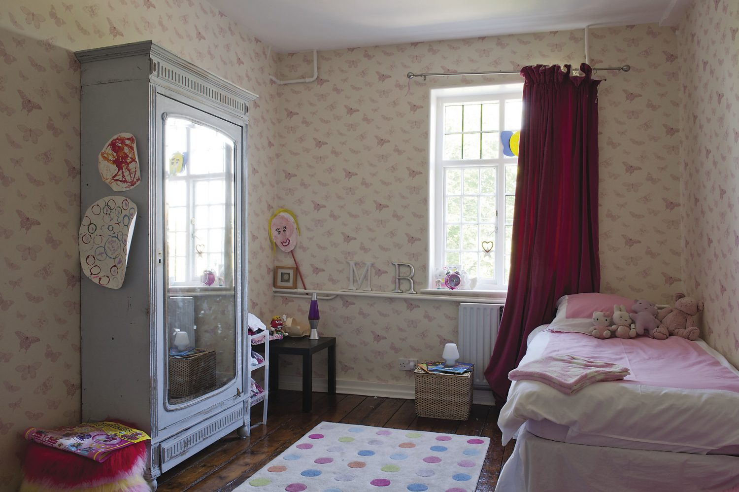 The younger children's bedrooms and bathrooms are grouped together and close to the panelled playroom