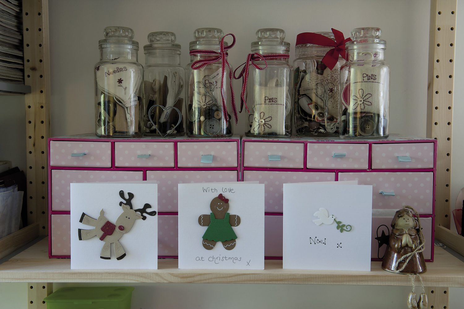 Kitty's workroom is home to birthday and Christmas cards adorned with paper cut-outs and vintage mother-of-pearl buttons as well as neatly arranged envelopes, ribbons, crisp tissue paper and shiny Cellophane