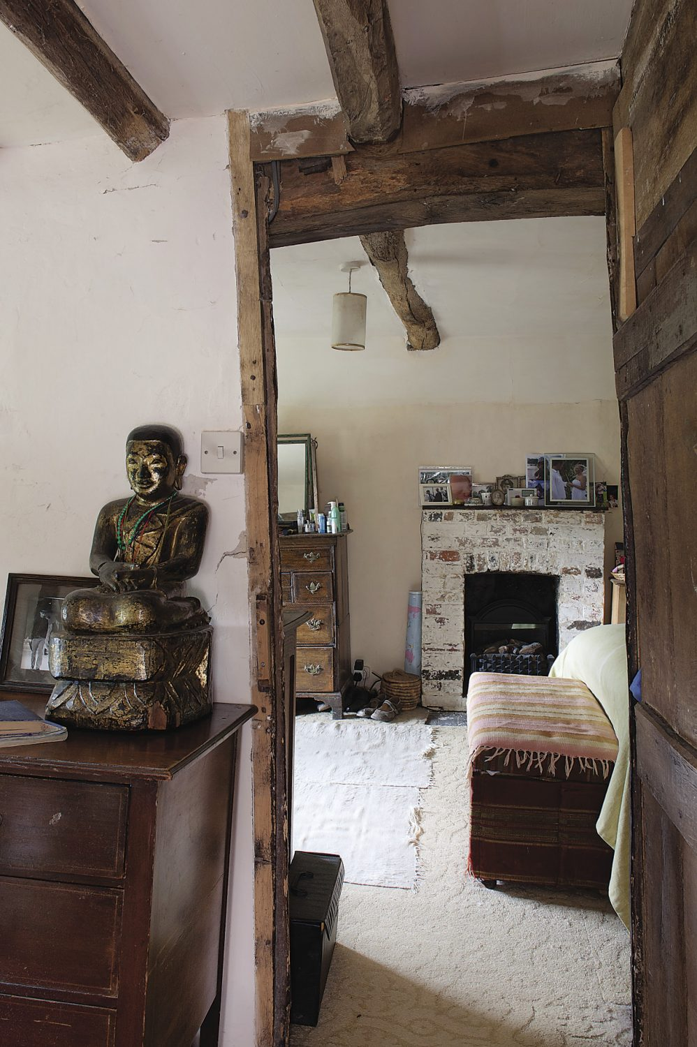Upstairs, past a visiting statue of the Buddha, is the main bedroom, its rollercoaster of a floor testament to the building's movement through the ages
