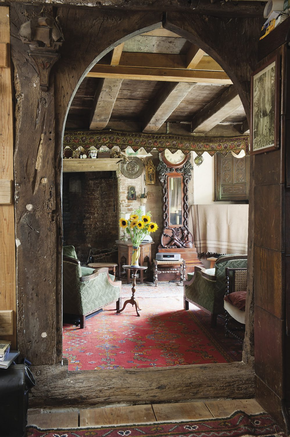 The study leads on to the drawing room or 'hall' dominated, perhaps a trifle smugly, by a massive and handsome grandfather clock that once belonged to Sarah's grandfather. The medieval lancet arch was discovered buried behind plasterboard