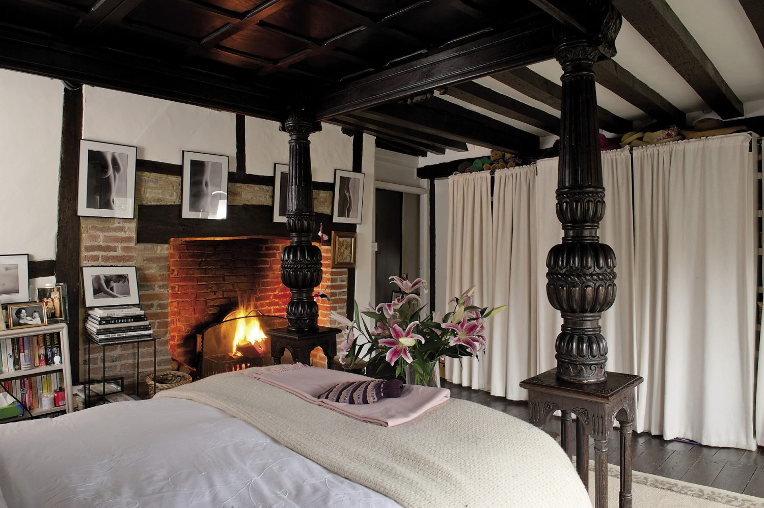 The master bedroom features a wonderful open fireplace