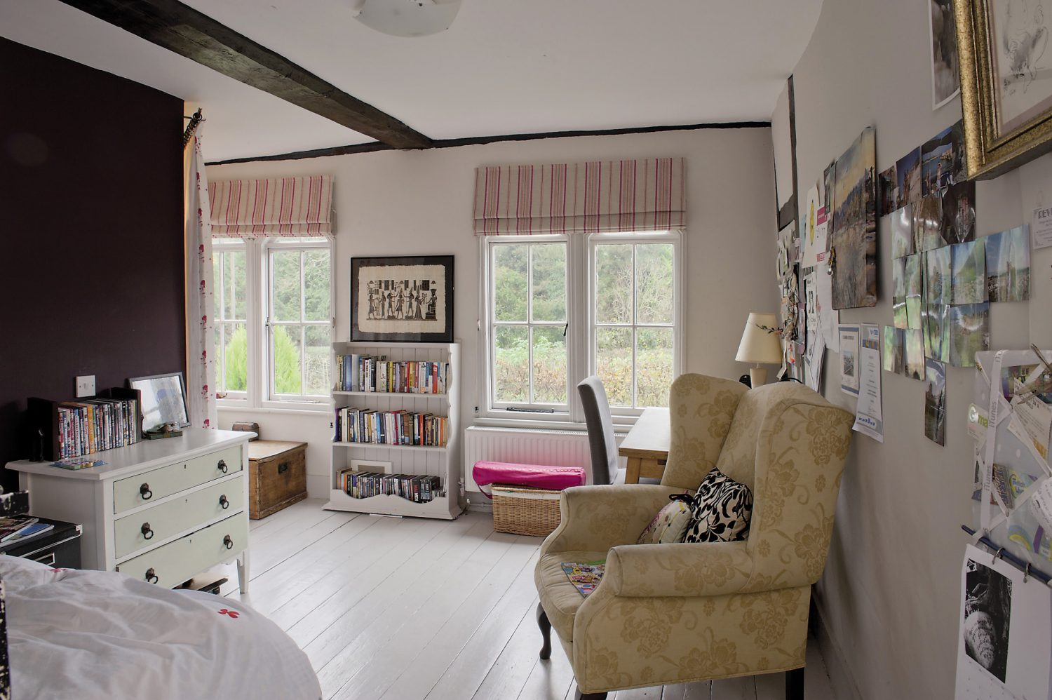 17-year-old daughter Chloë's light bright room features white painted floors and furniture. Behind a white and rose print curtain hides her own bathroom...