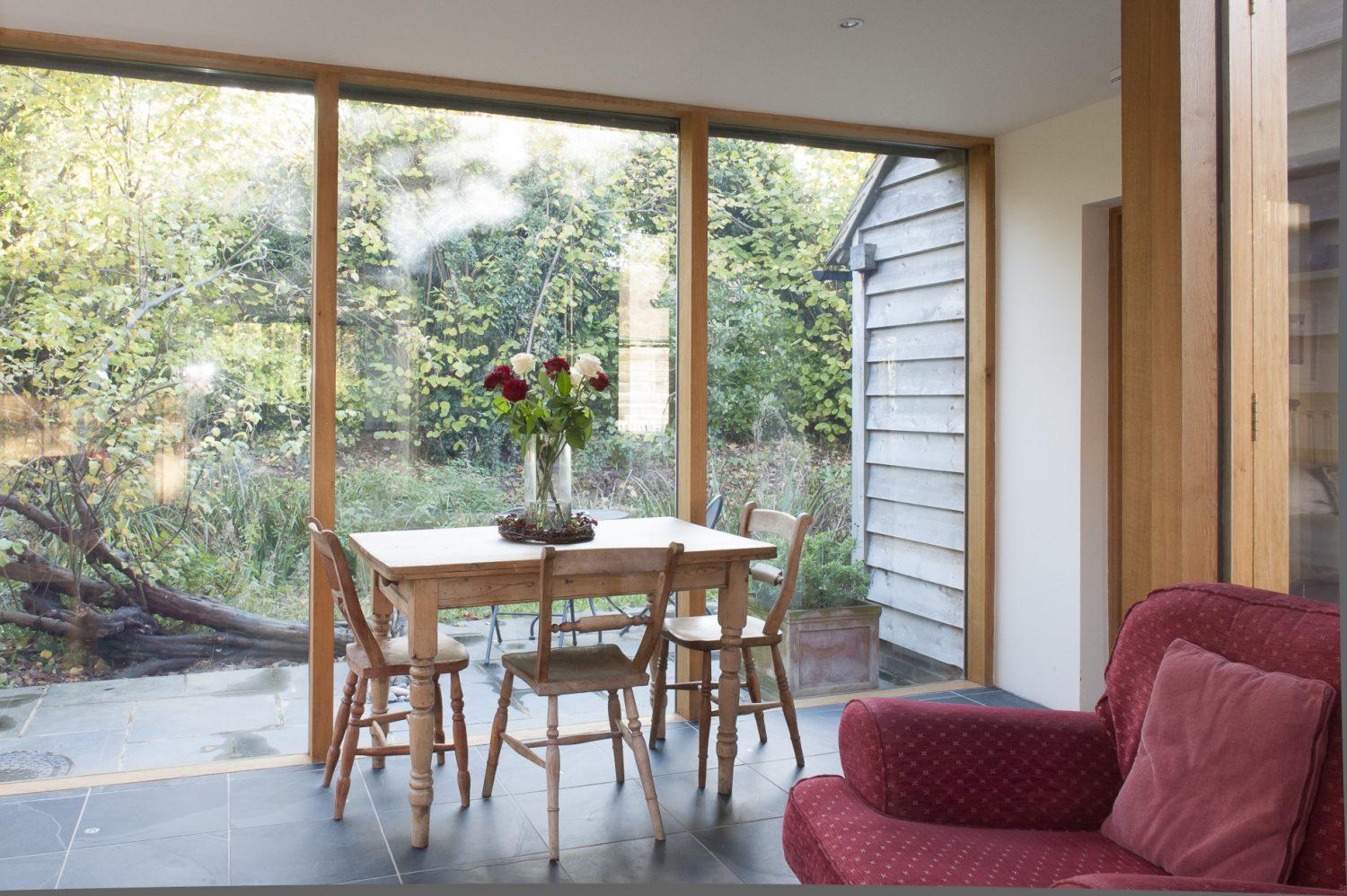 A linking room which joins the kitchen to the converted barn is more akin to a relaxing garden room
