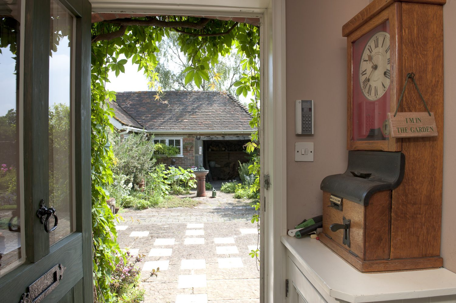 The front door leads straight out into the couple's beautiful garden
