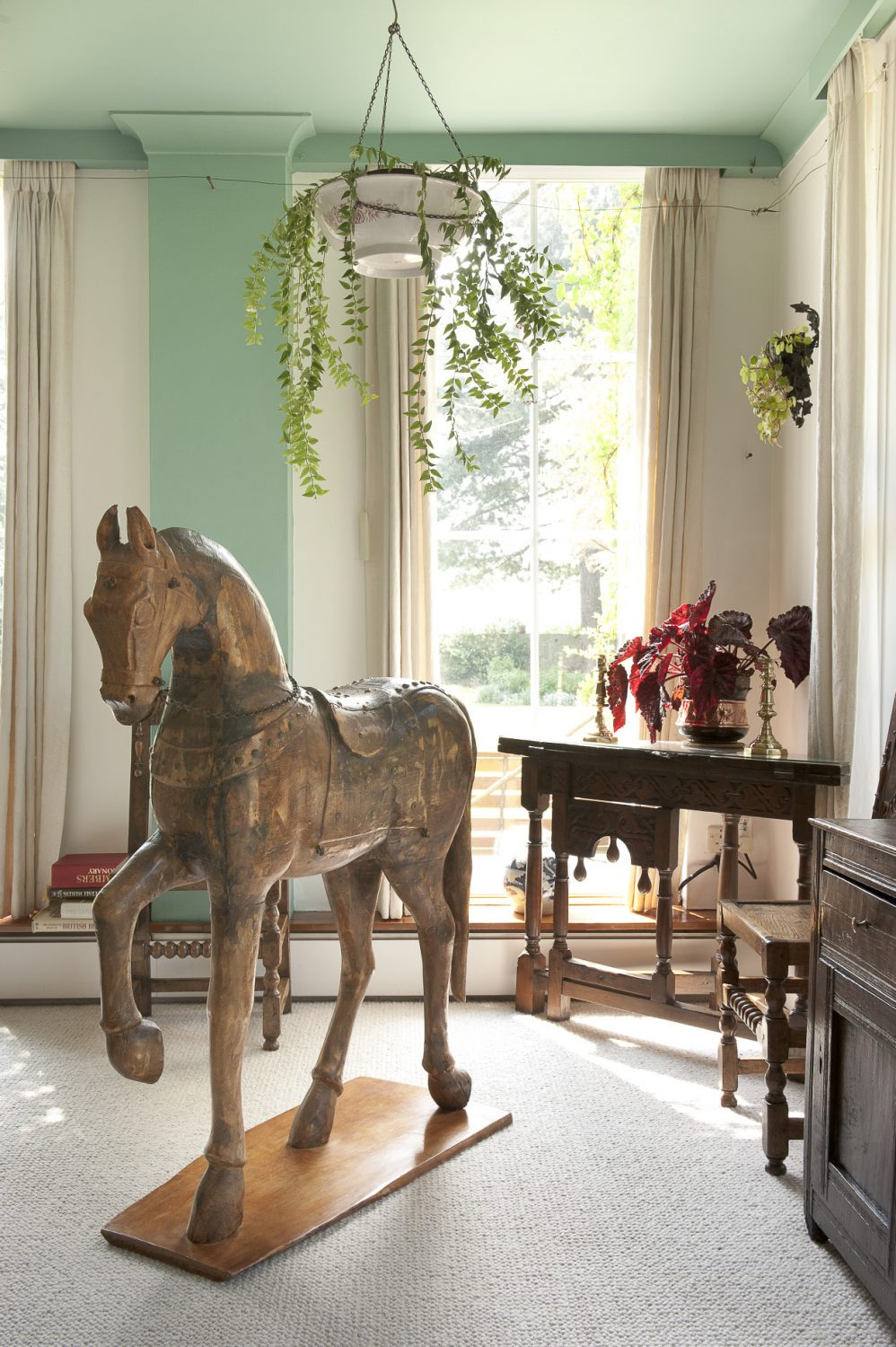 In the opposite corner of the room stands a wooden statue of a Mongolian pony that came from Afghanistan