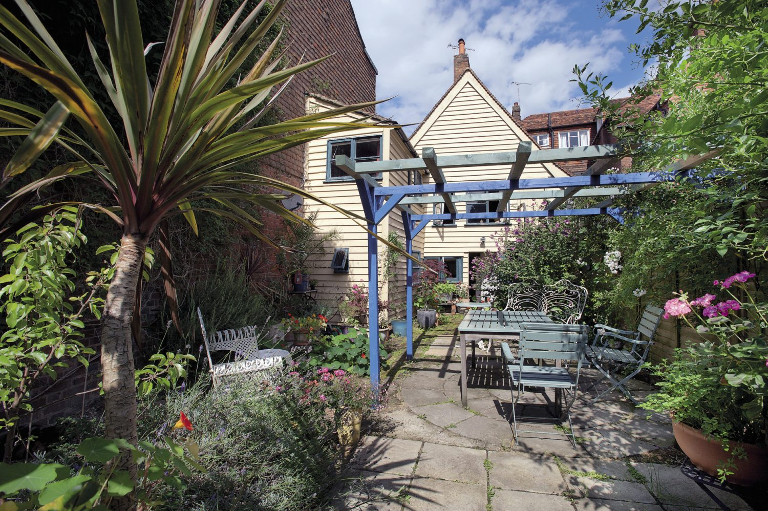 The beautifully secluded courtyard garden is a welcoming retreat