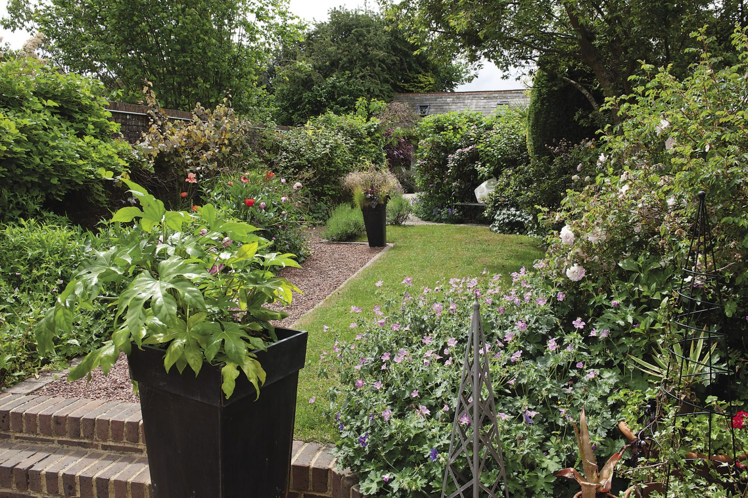 The garden faces south and is divided into three sections, cleverly adding interest to what is essentially quite a long and narrow plot