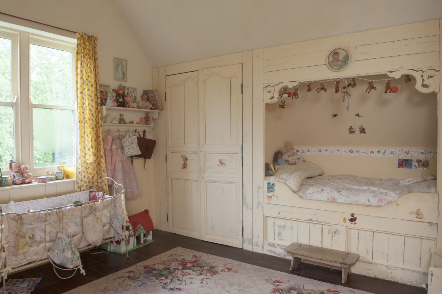 Her bed has been built into the wall in the Russian or Scandinavian style, with a cupboard to one side and drawers underneath