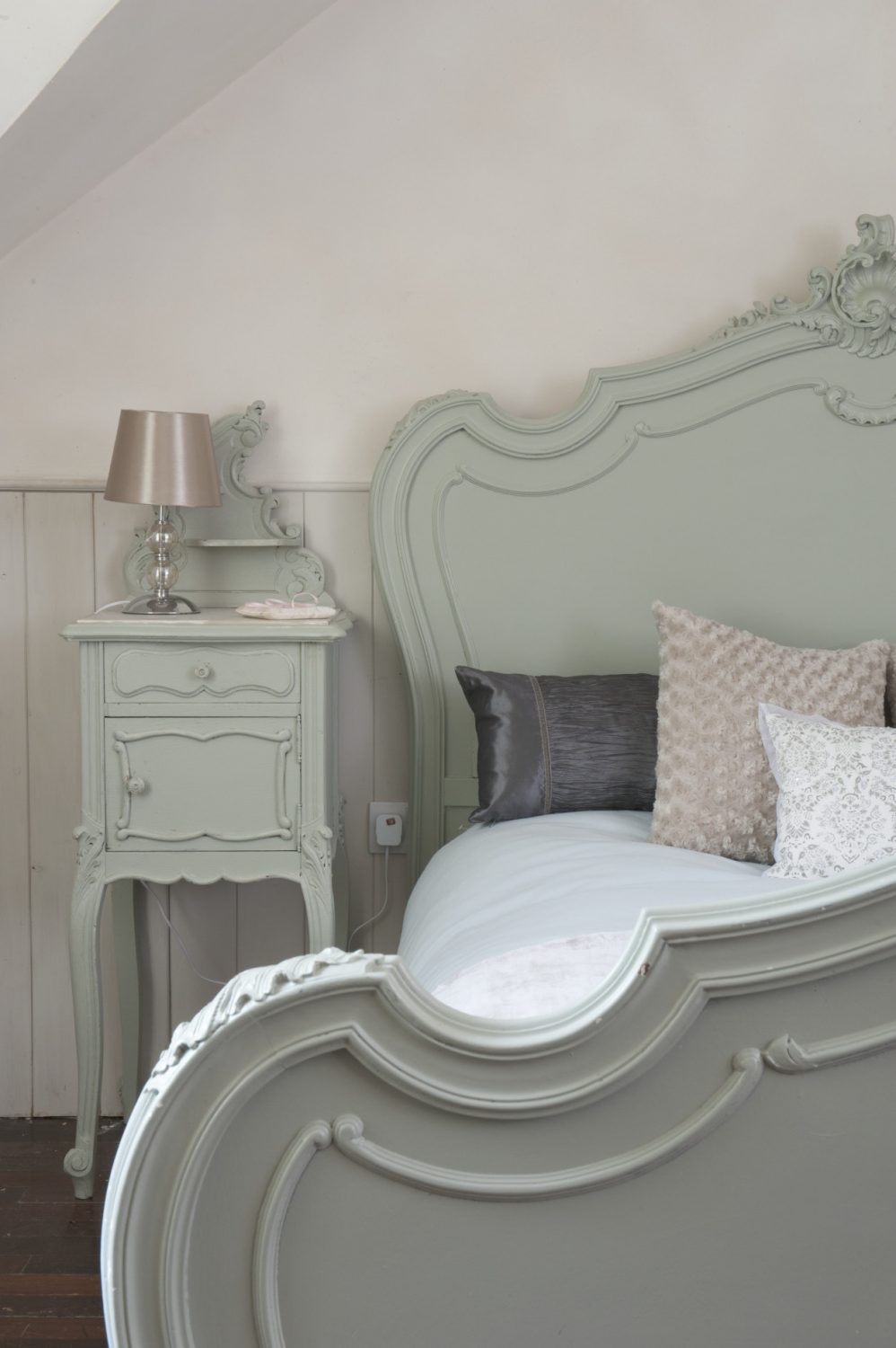 Cookie's well-ordered bedroom is a serene sanctuary of light grey and shell pink