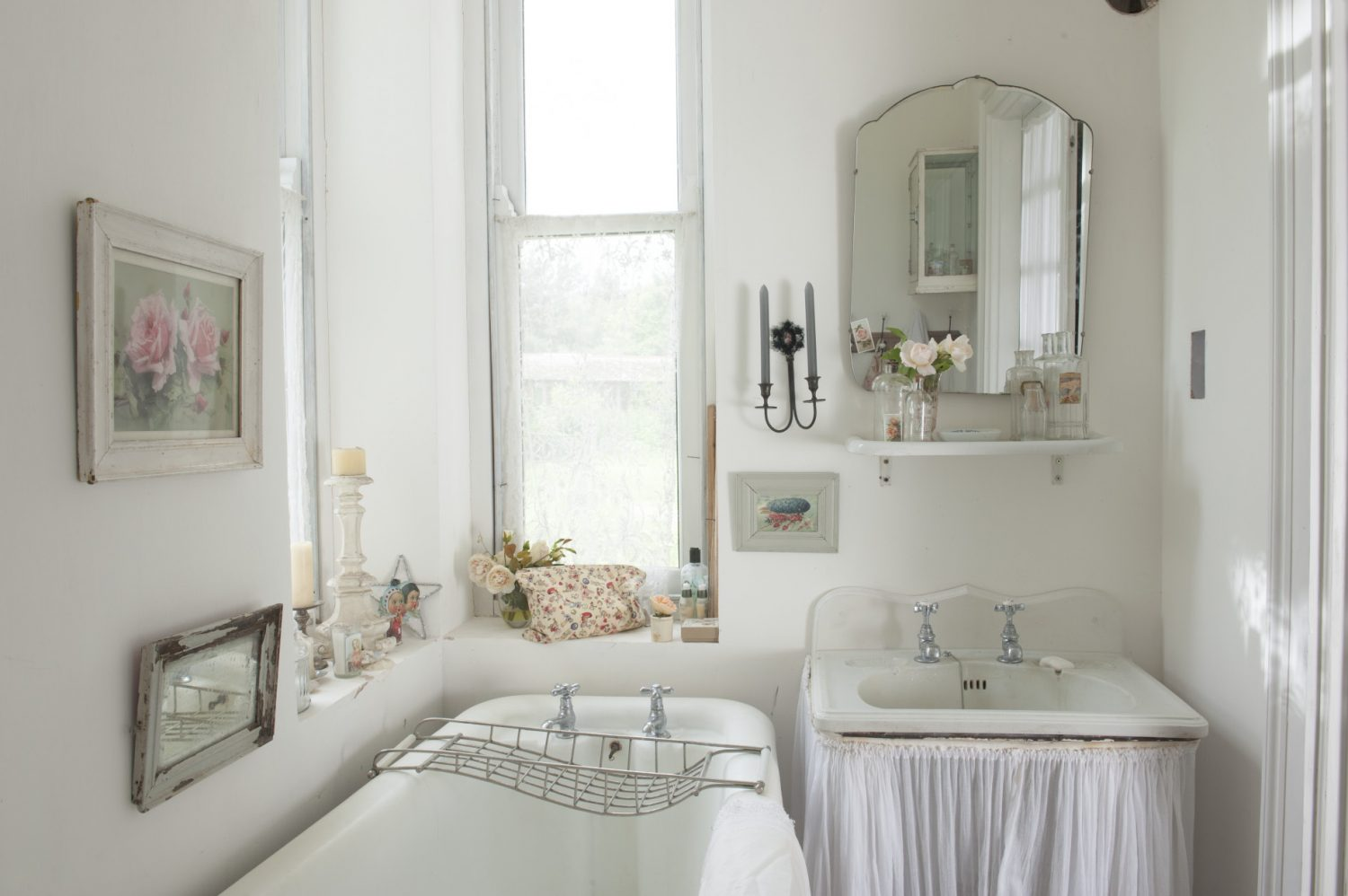 n the downstairs bathroom a pair of narrow glass panelled doors are hung with tightly gathered muslin curtains for privacy