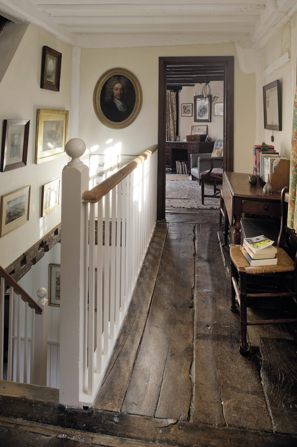 The floorboards here on the landing are almost two feet wide and career off at a comically steep angle towards the oriel window in the guest bedroom