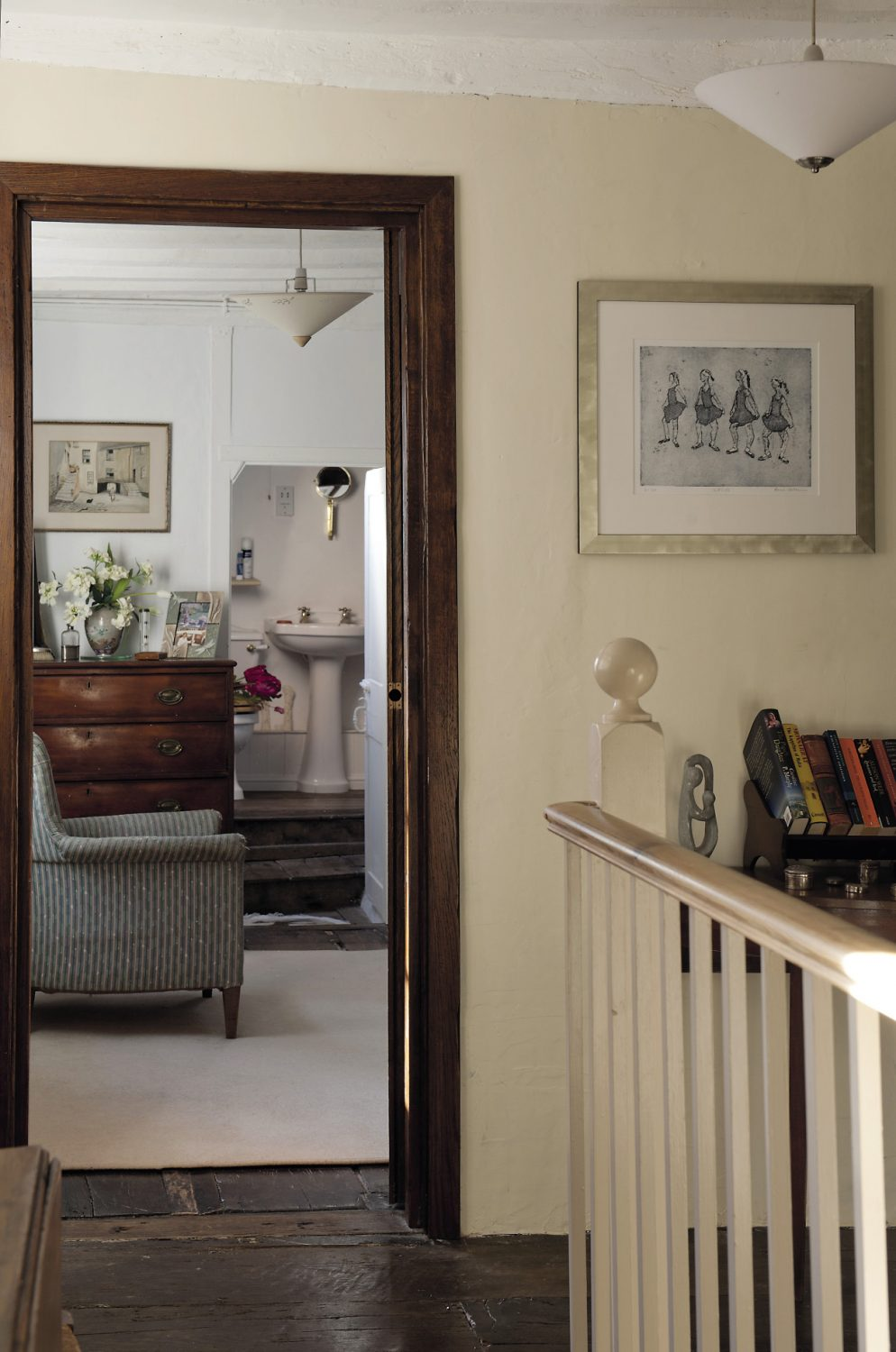 An etching of ballerinas by local artist Anne-Catherine Phillips is positioned at the top of the stairs up to the landing