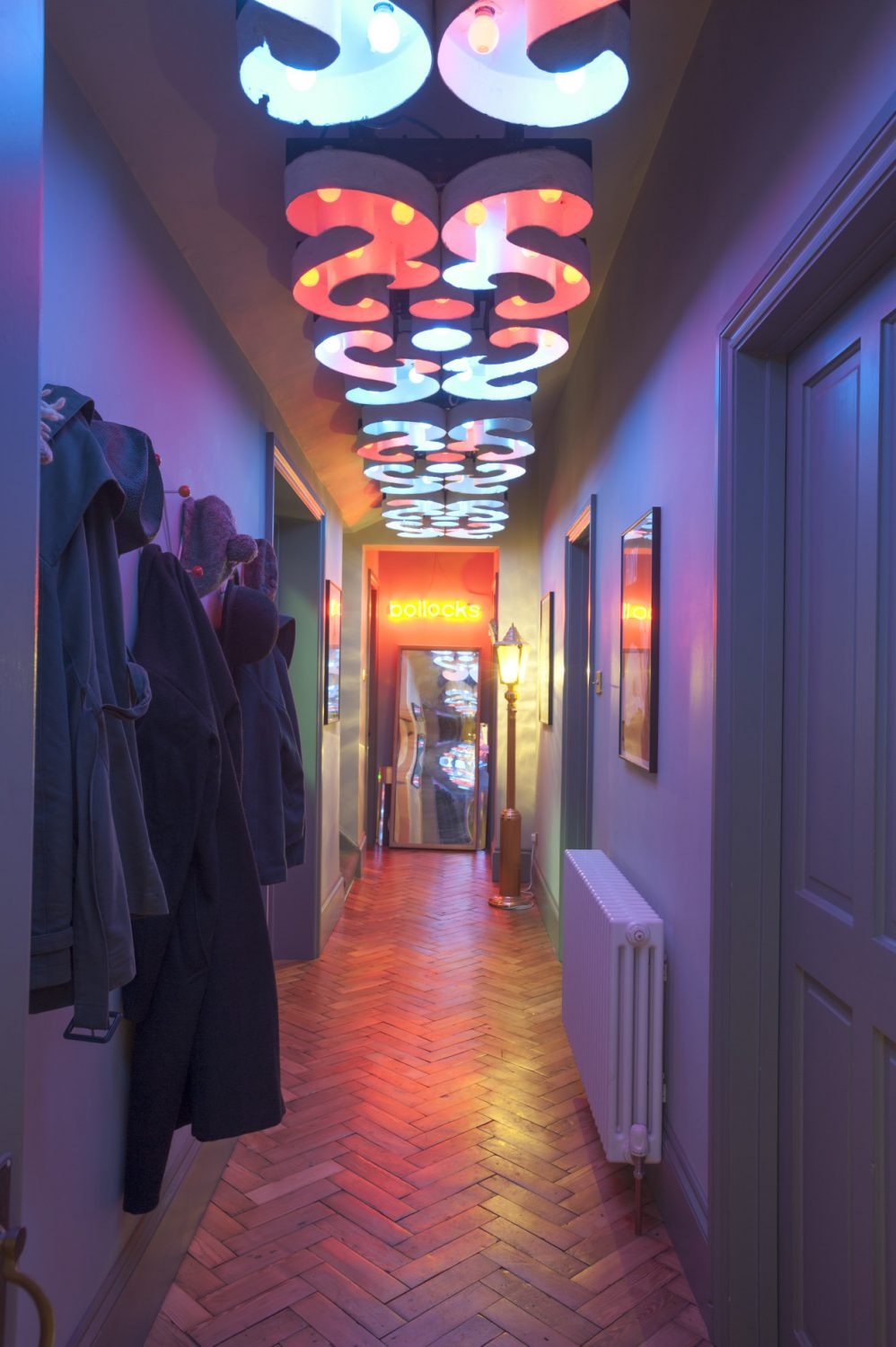 The long hallway, which greets visitors who enter the living accommodation, is lit by a ceiling covered with pieces from Blackpool and fitted with blue and red golf ball LEDs