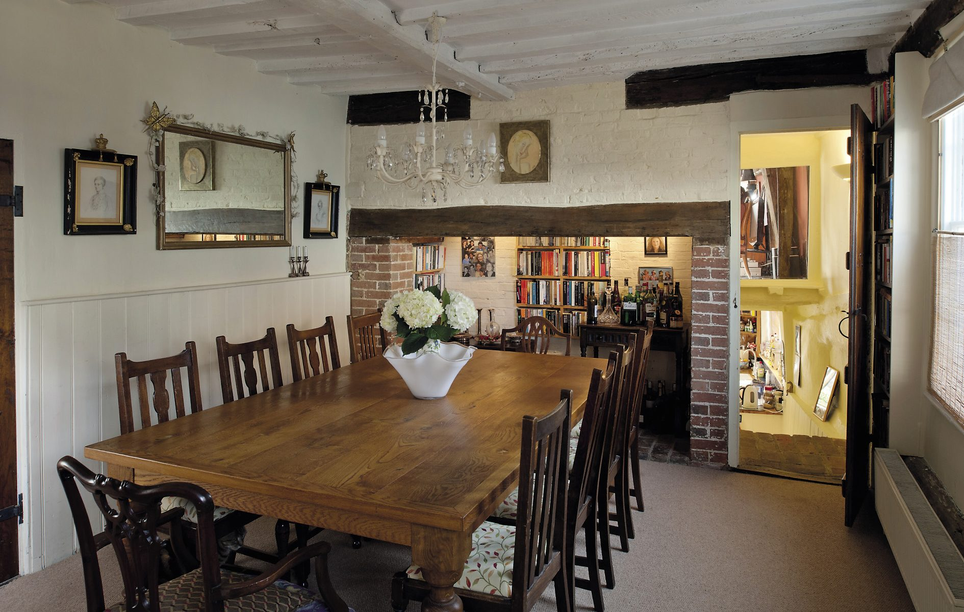The dining room table, surrounded by Edwardian oak chairs that were inherited from Mary's family, is exceptionally generously proportioned and testifies to the couple's love of large, sociable gatherings
