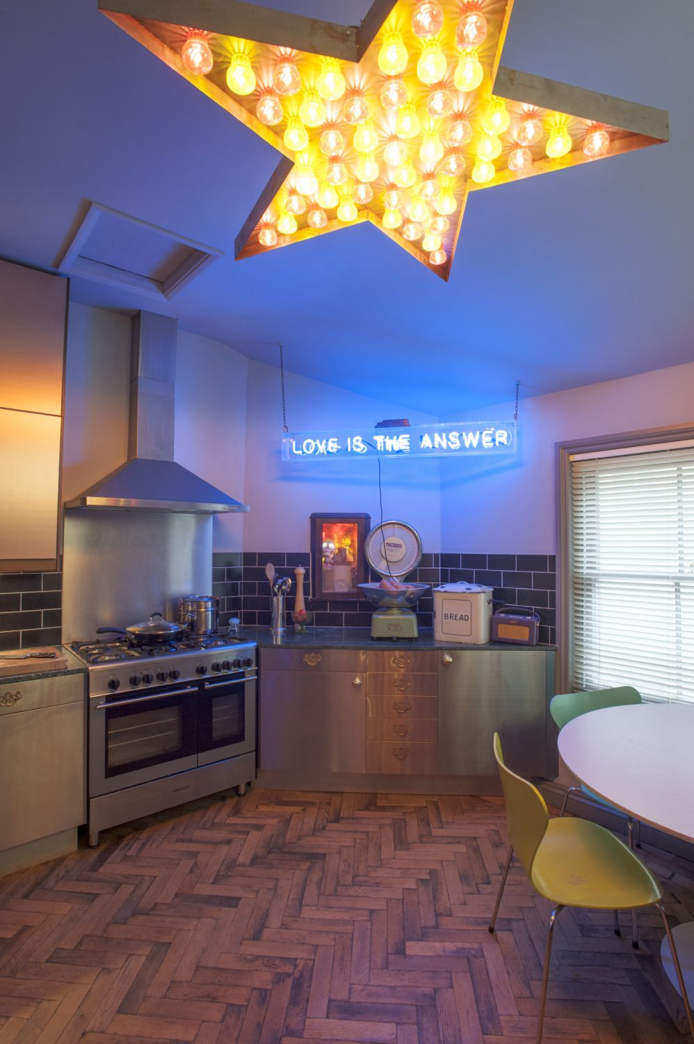 Centrepiece of the kitchen is a giant ceiling-mounted star. The copper-fronted units that Philip and Olivia found in IKEA reflect the light into every corner of the room