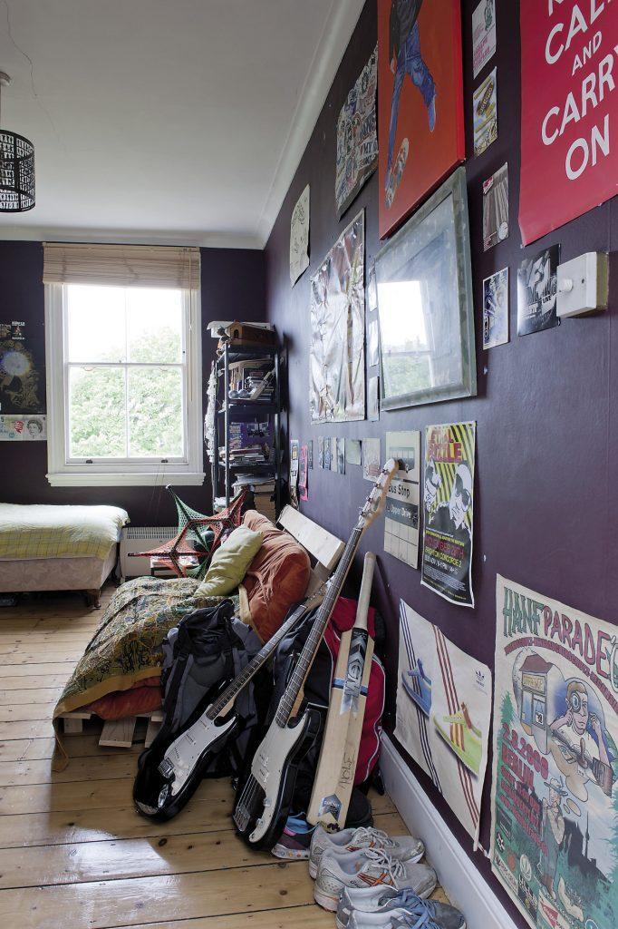 Orlando and Joanna's son's room is painted a deep aubergine purple