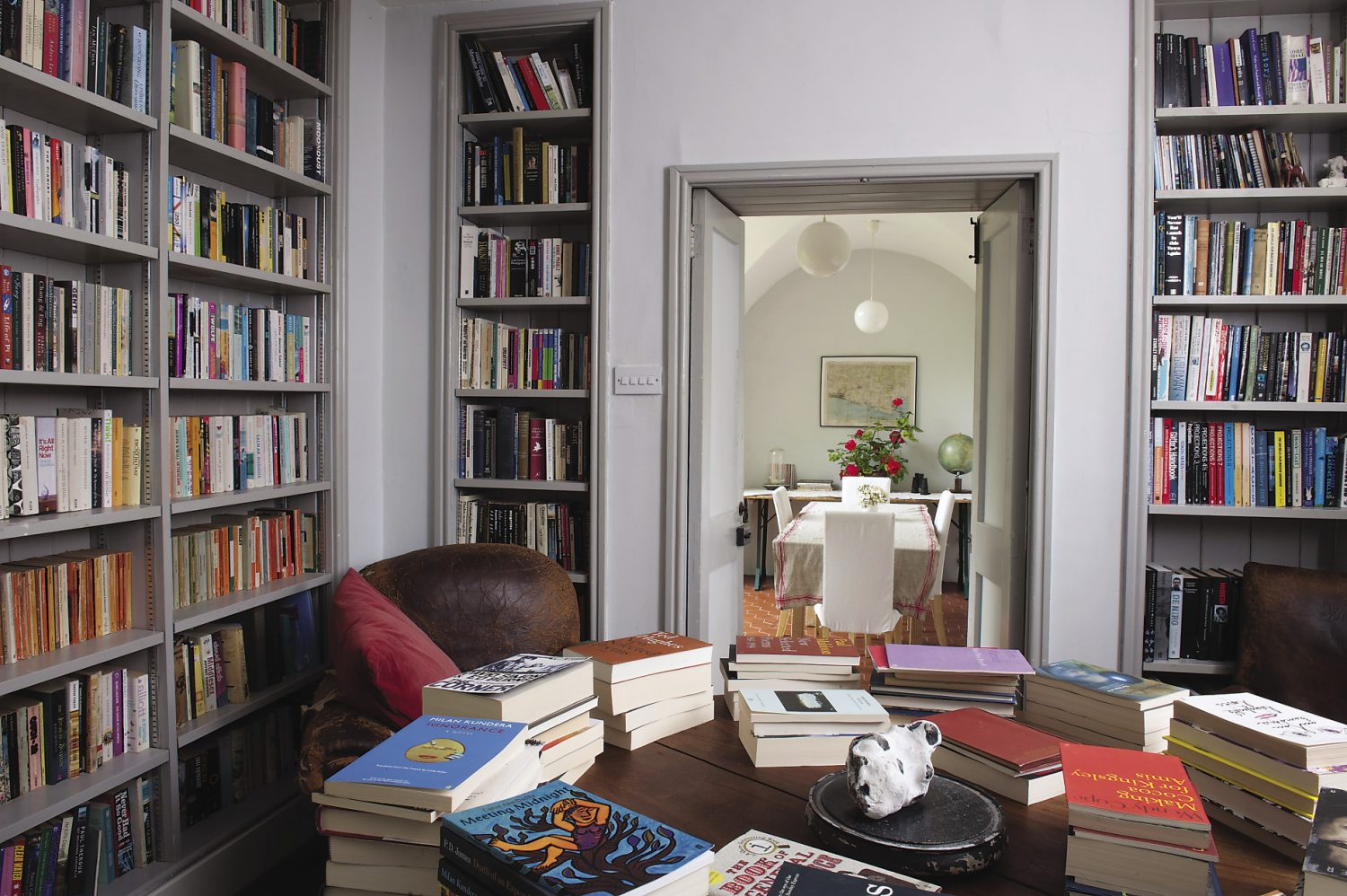 An anteroom is used according to the guests' requirements as a breakfast room, games room or chill-out space. There are floor to ceiling shelves stuffed with books, and between two leather club chairs, a circular mahogany table also offers a carefully arranged selection of more fiction along with plenty of field guides, including the now highly collectable Observer guides