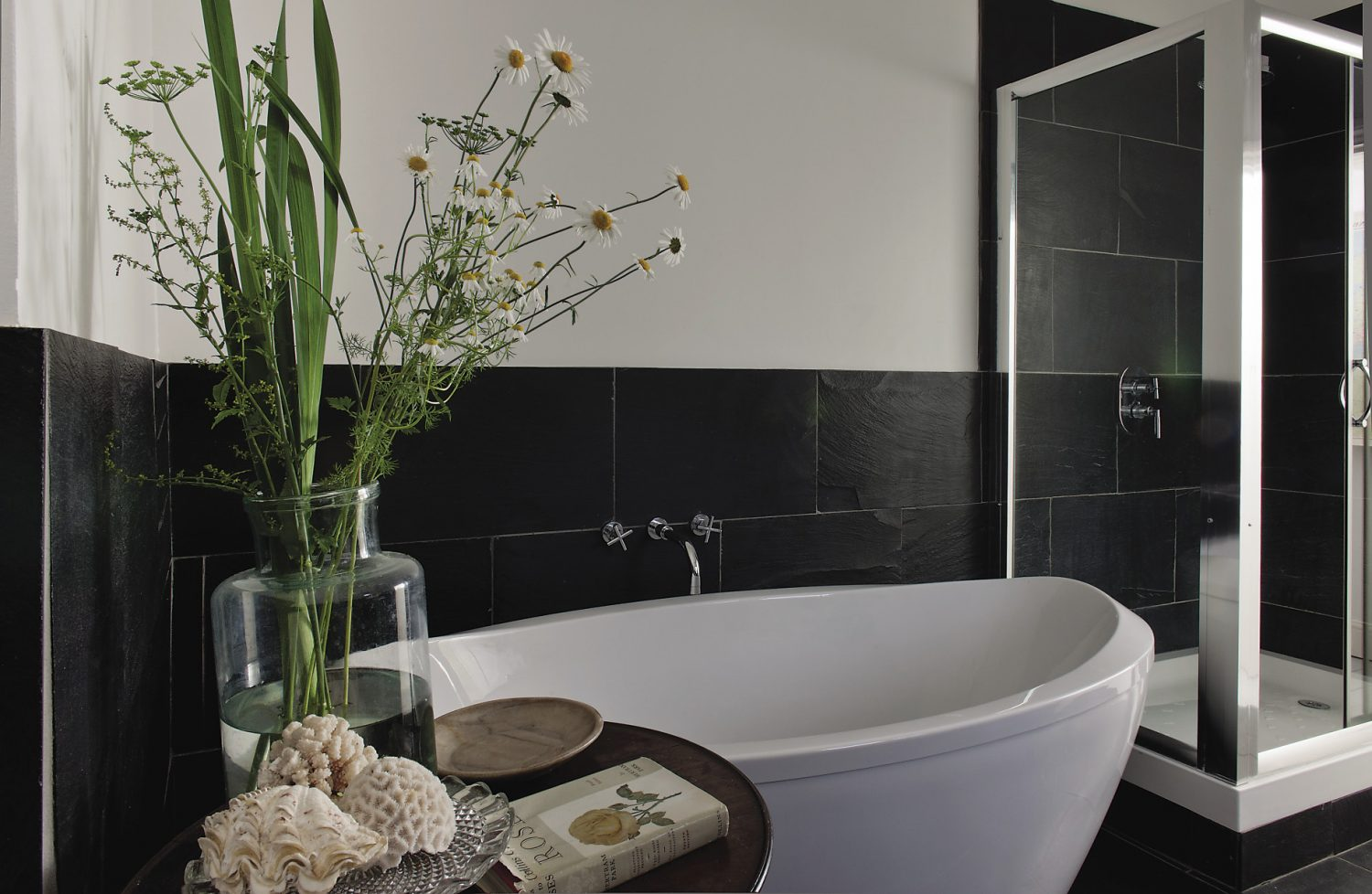 An immaculately presented bedroom and bathroom feature crisp monochrome colour schemes and more of Polly's freshly-picked flower arrangements