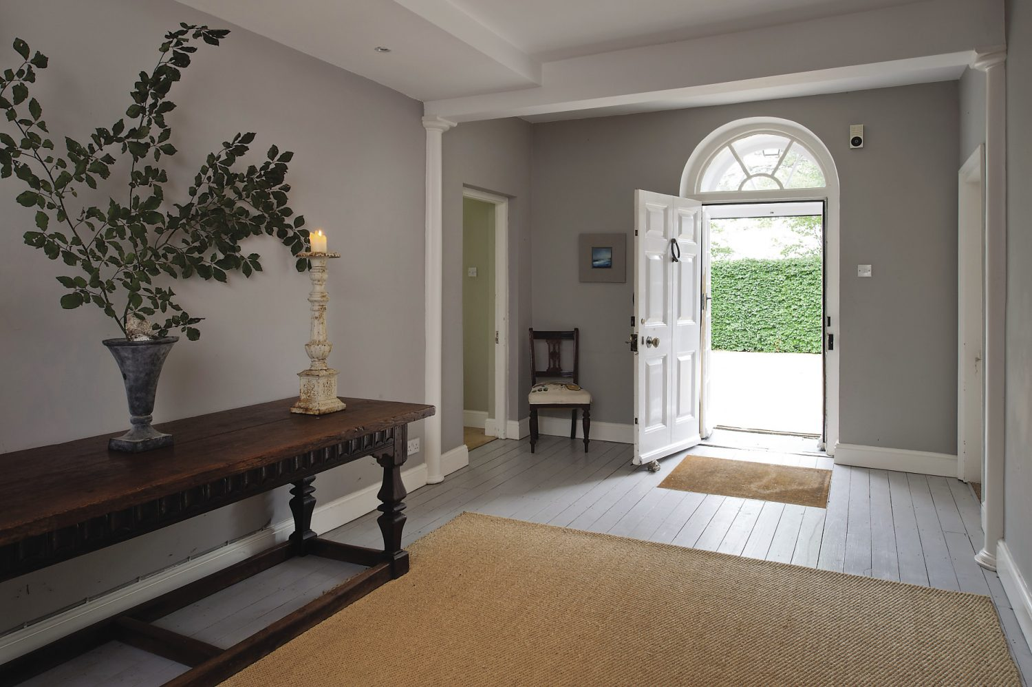 The generously proportioned entrance hall leads through into the kitchen