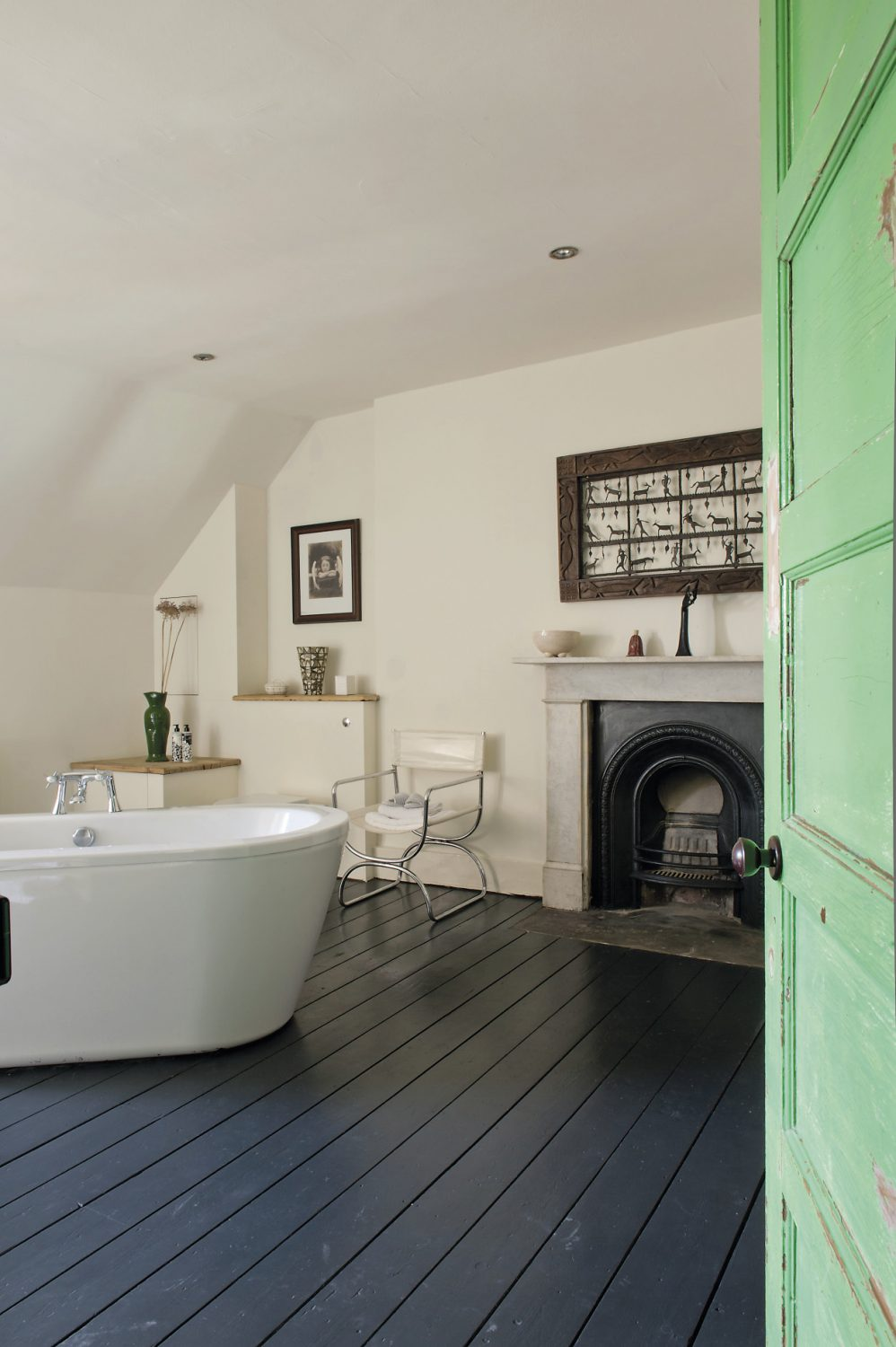 Centrepiece – literally – of the bathroom is a white free-standing bath, set off beautifully by the black painted floorboards...