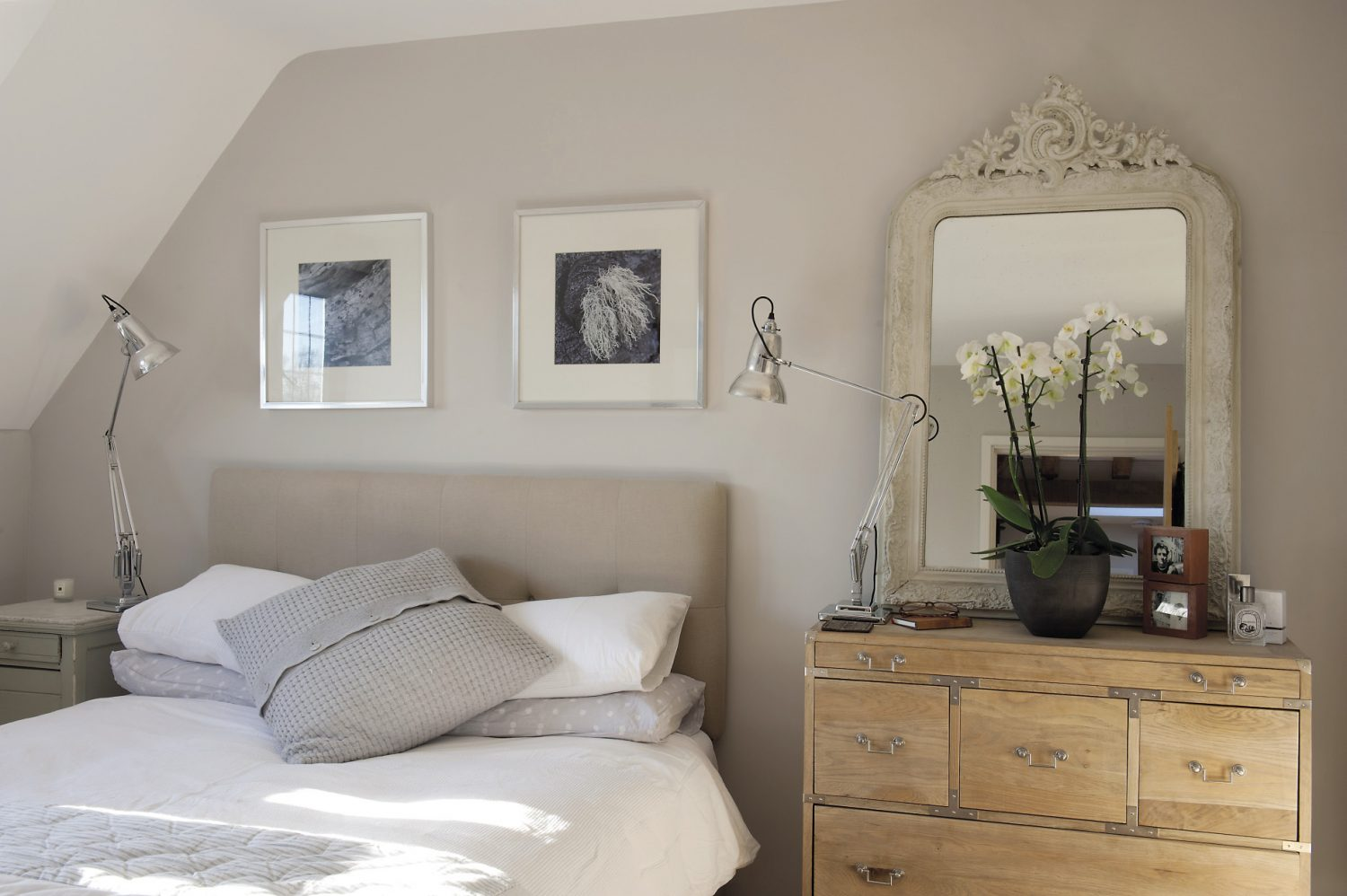 The master bedroom with its en suite bathroom is a cornucopia of Heirloomia. Flanking the bed are two re-chromed and rewired 1940s Anglepoise lamps atop a limed oak campaign-style chest of drawers and a marble-topped bedside table