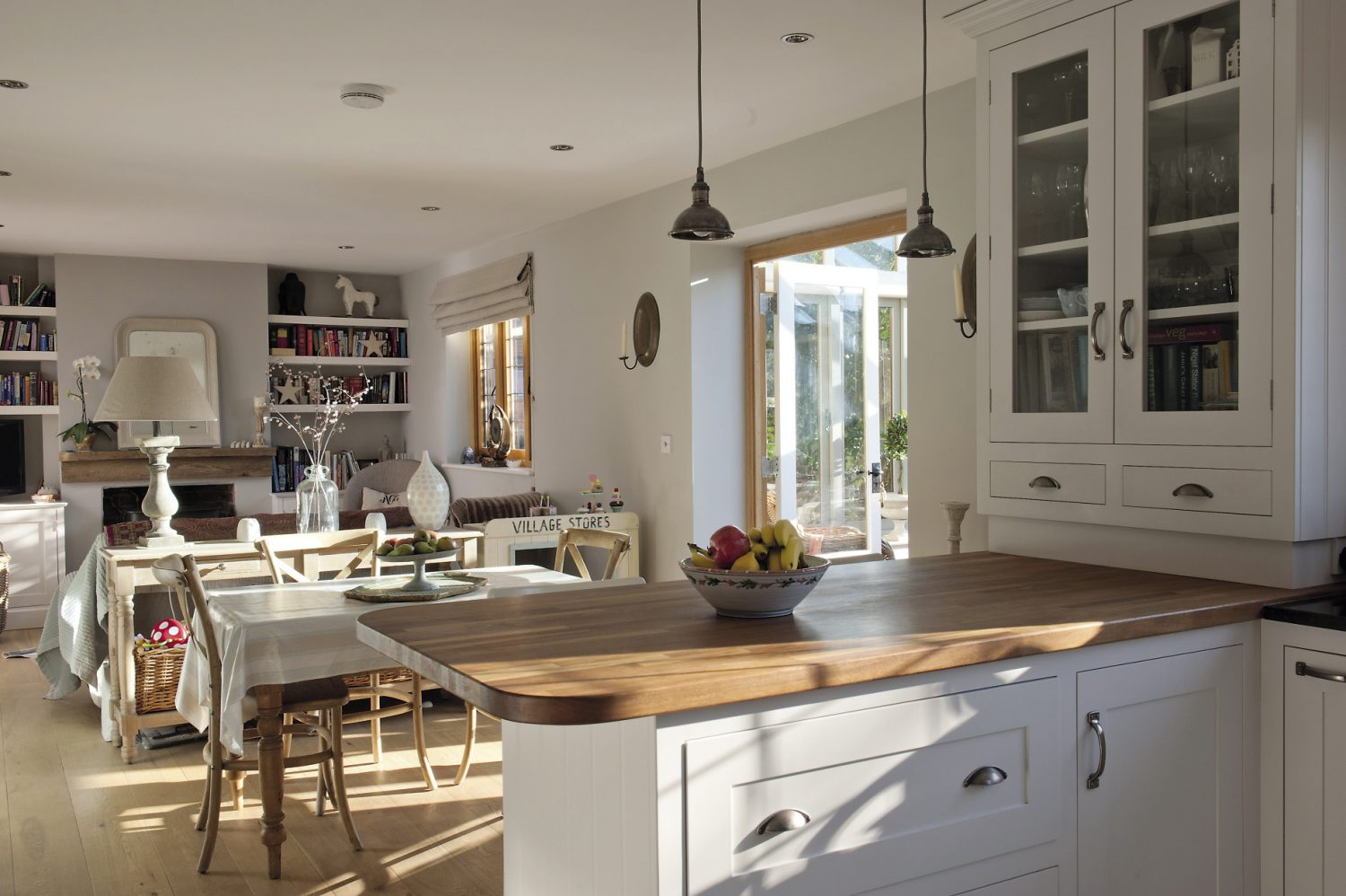 """The kitchen features iroko worktops and factory-esque metal pendant lights """"I love to mix period industrial, commercial and home pieces,"""" says Victoria. """"It's often surprising just how well they go together."""""""
