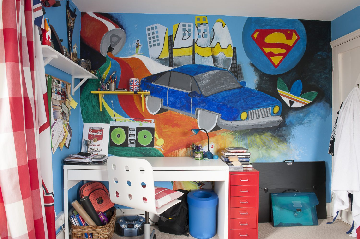 In son Dominic's room a whole wall above his desk is devoted to a spectacular mural