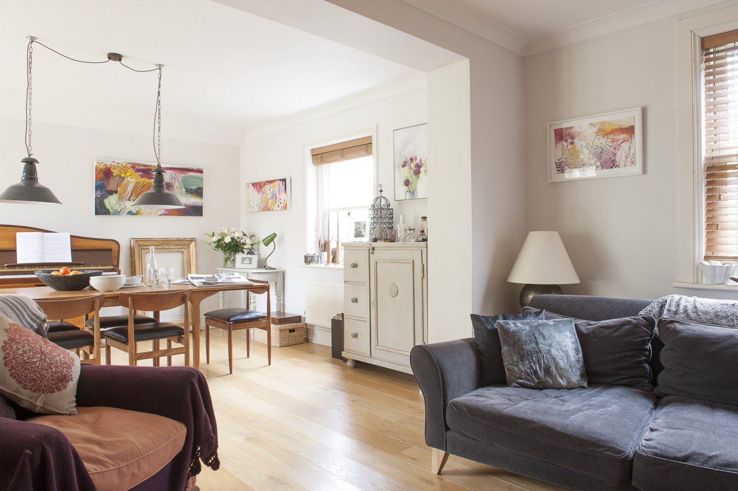 The open plan sitting room and dining area is an eclectic mix of styles that somehow work perfectly