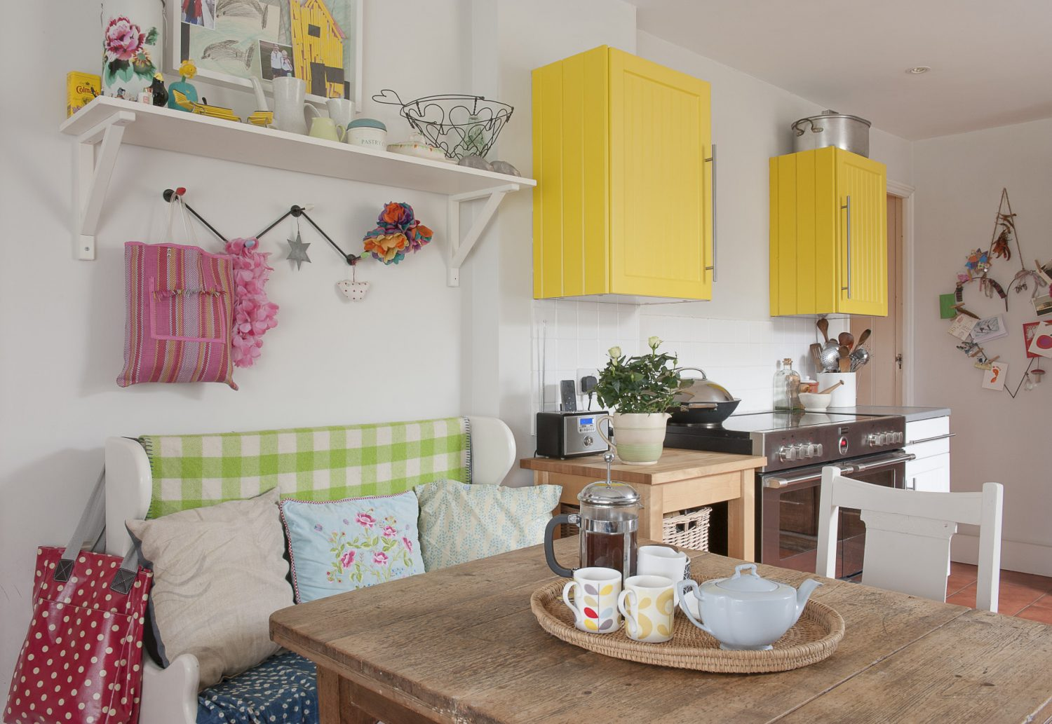 Canary yellow cupboards add a vibrant touch to the kitchen