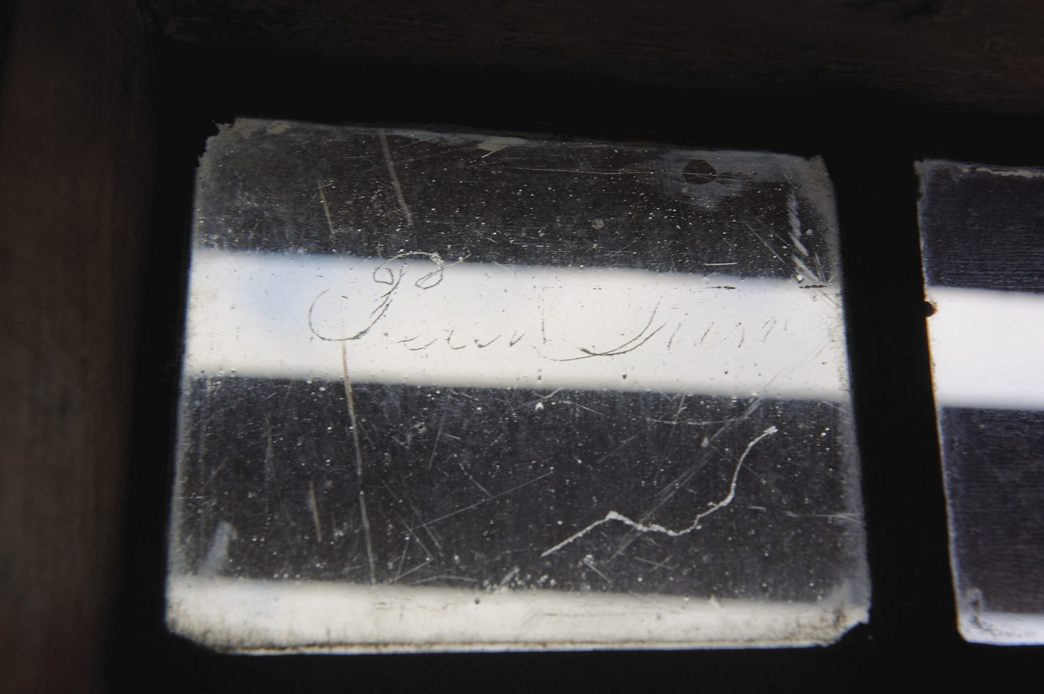 . In one tiny pane of glass there is a signature in neat copperplate script: W.C. Laymouth, February 9th 1872. And high up at the top, David and Daphne have recently spotted another signature, but this time it has been etched on the glass from the outside